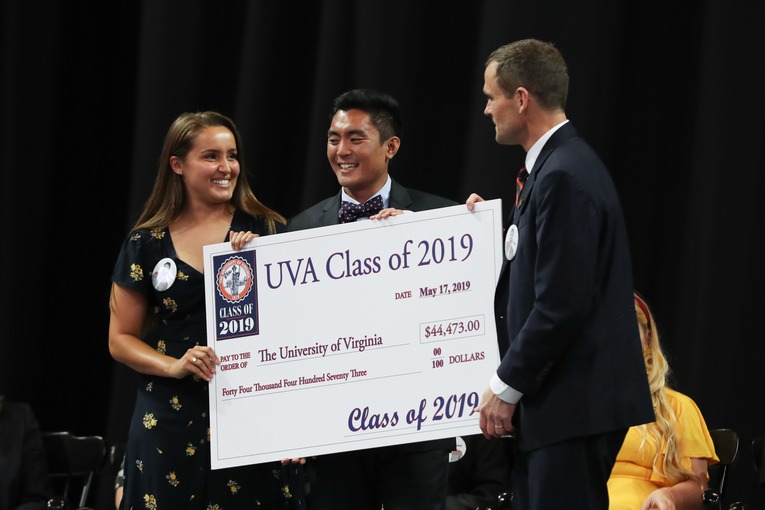 The Class of 2019 raised more than $44,000 for UVA. President Jim Ryan accepted the check during Friday's Valedictory Exercises from Class Giving Campaign members Rachel Clark and Paco Abiad.