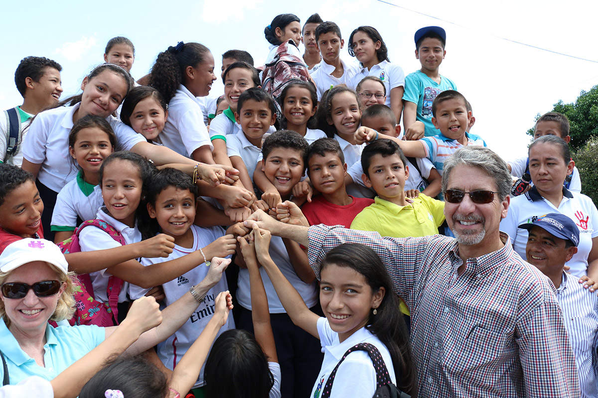 U.S Ambassador to Colombia Kevin Whitaker is greeted by children at Campo Hermoso in the Colombian department of Caquetá, during his recent visit to USAID projects in the area. (Photo curtesy of U.S. Embassy in Colombia)