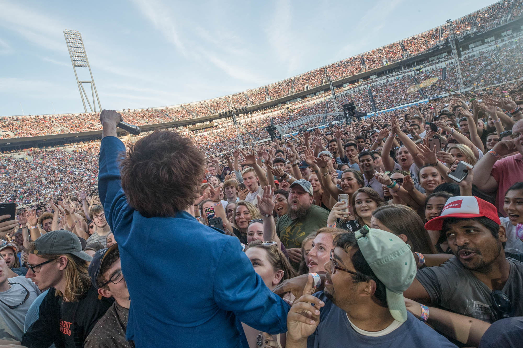 The singer from Cage the Elephant sings to a large crowd