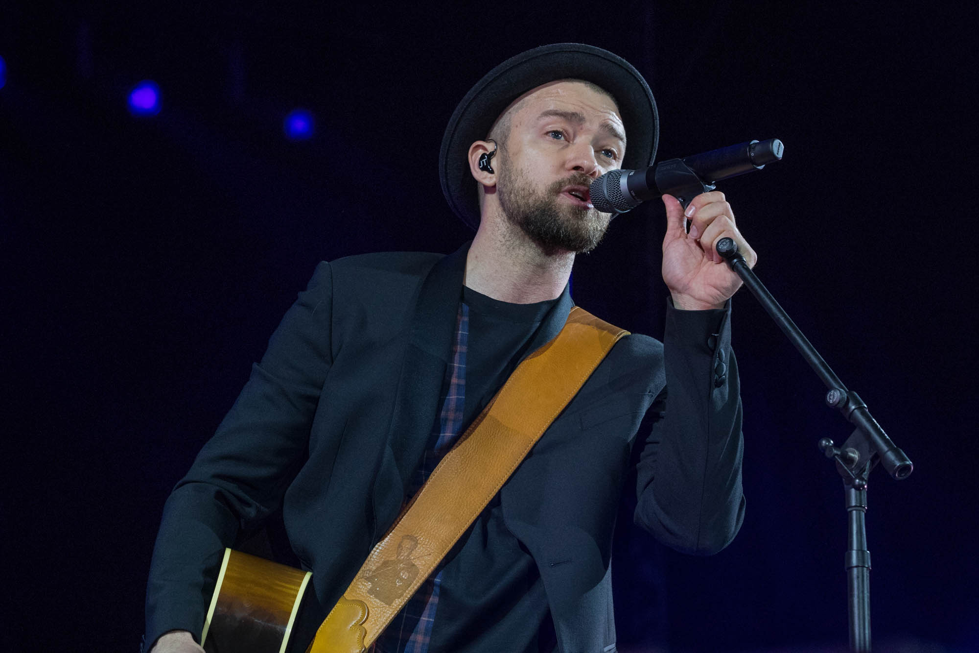 Justin Timberlake sings into a microphone