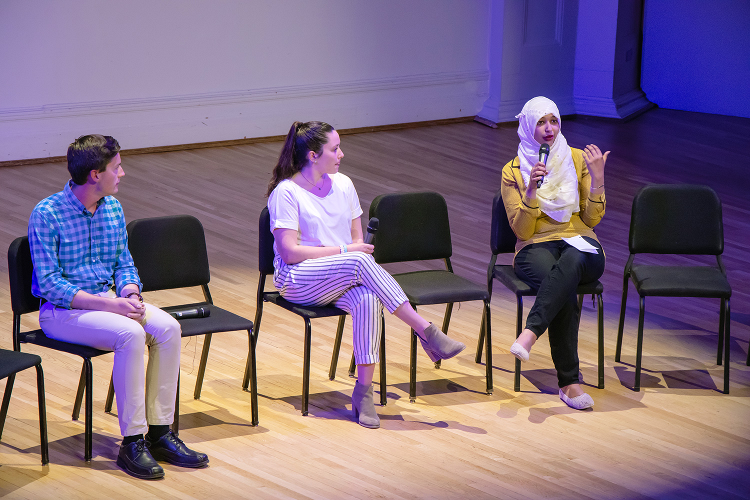 "First-year students, from left, Trevor Doiron, Martha Gallagher and Wafa Salah discuss what they learned from taking the new curriculum ""Engagements"" courses."