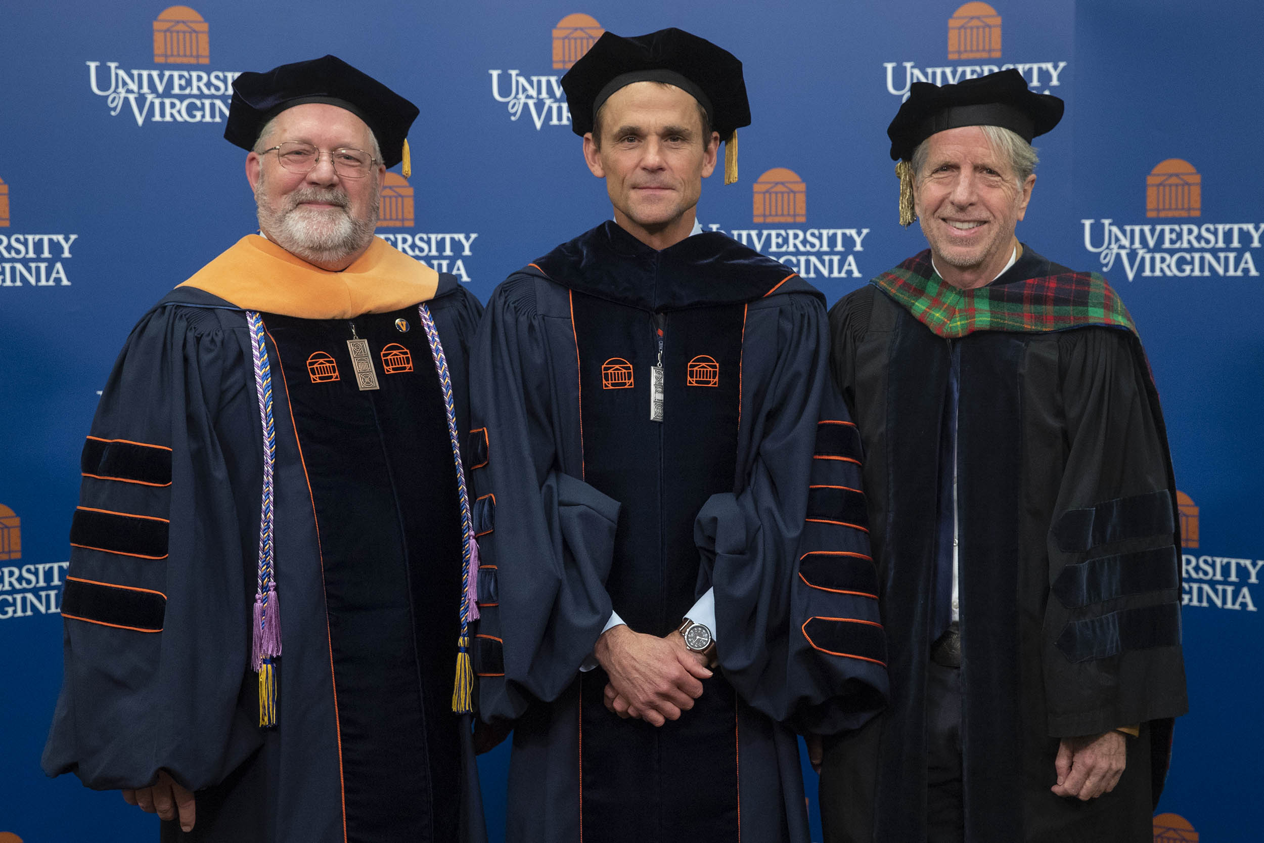 UVA President Jim Ryan, center, bestowed the University's Thomas Jefferson Awards upon Richard Carpenter (service), left, and Charles Holt (scholarship).