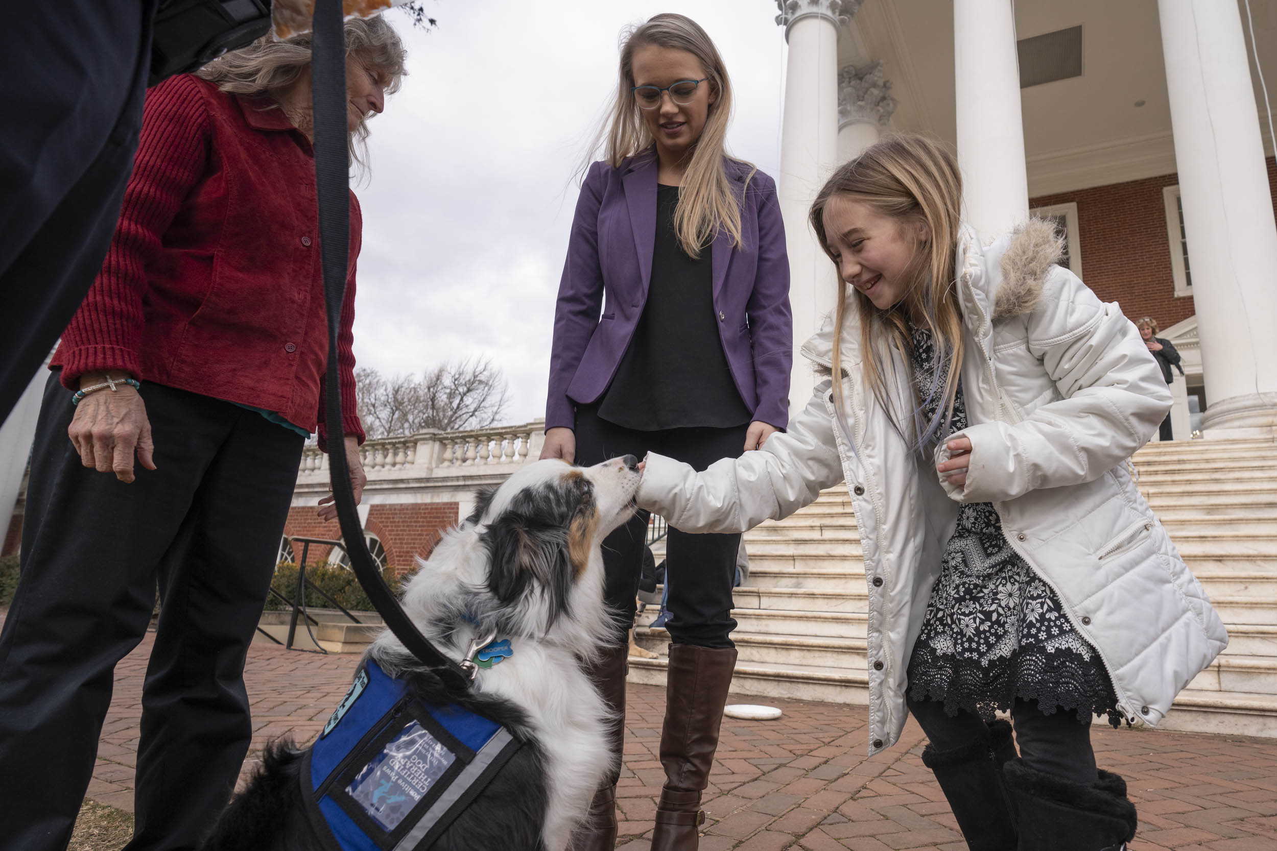 """Nine-year-old Timberly Scott of Surrey was in Charlottesville for the funeral of her uncle, Joshua James Scott. She said she likes dogs because """"they're soft and sweet."""""""