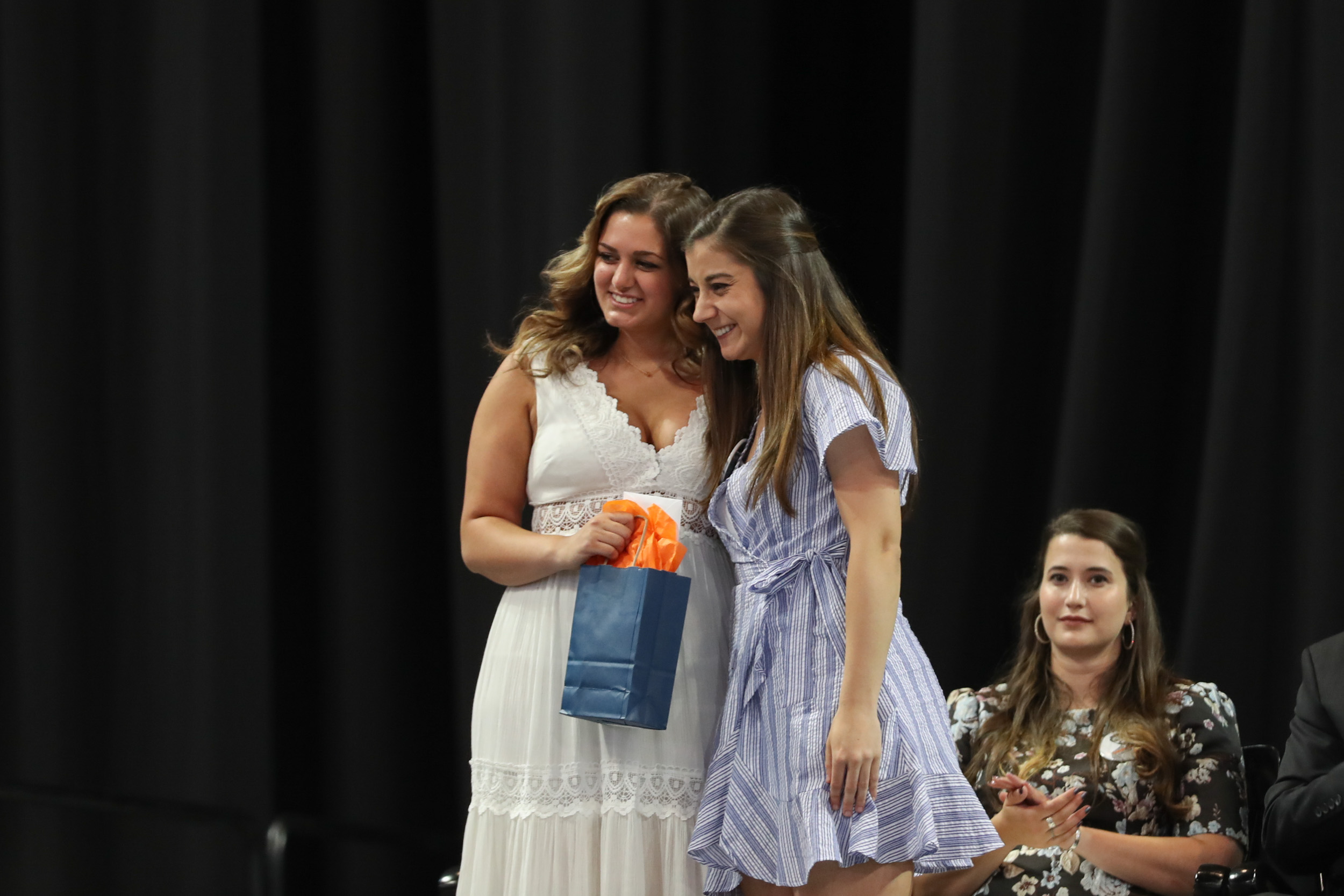The Class of 2019, represented by trustee Mariana Brazao, right, presented its Class Award for Community Service to anthropology major Corinne Singh.
