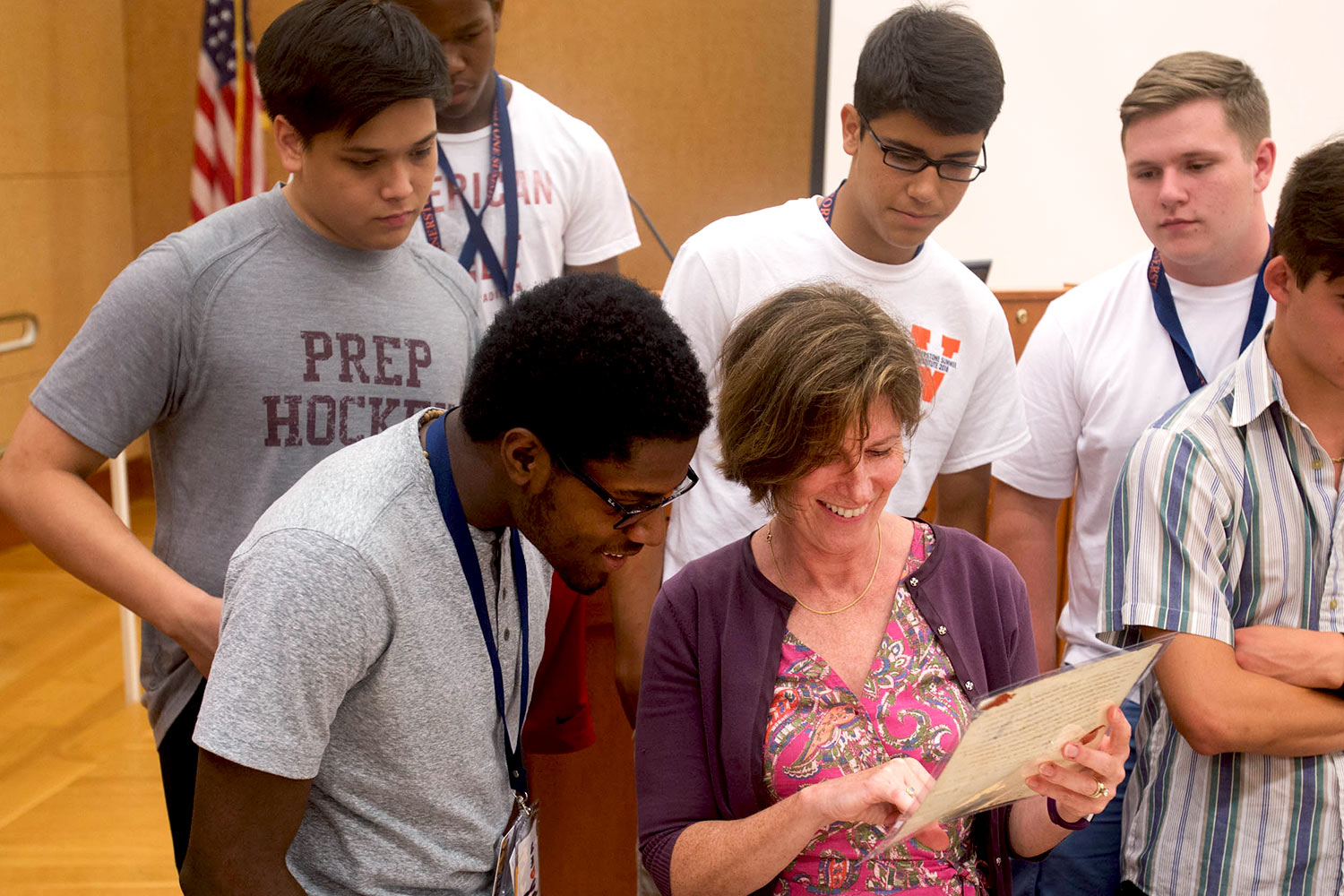 Riser, center, shows another Jefferson letter to Shawn Thomas of Woodbridge, left, and other students at the Cornerstone Summer Institute. (Photo by Sanjay Suchak/University Communications)