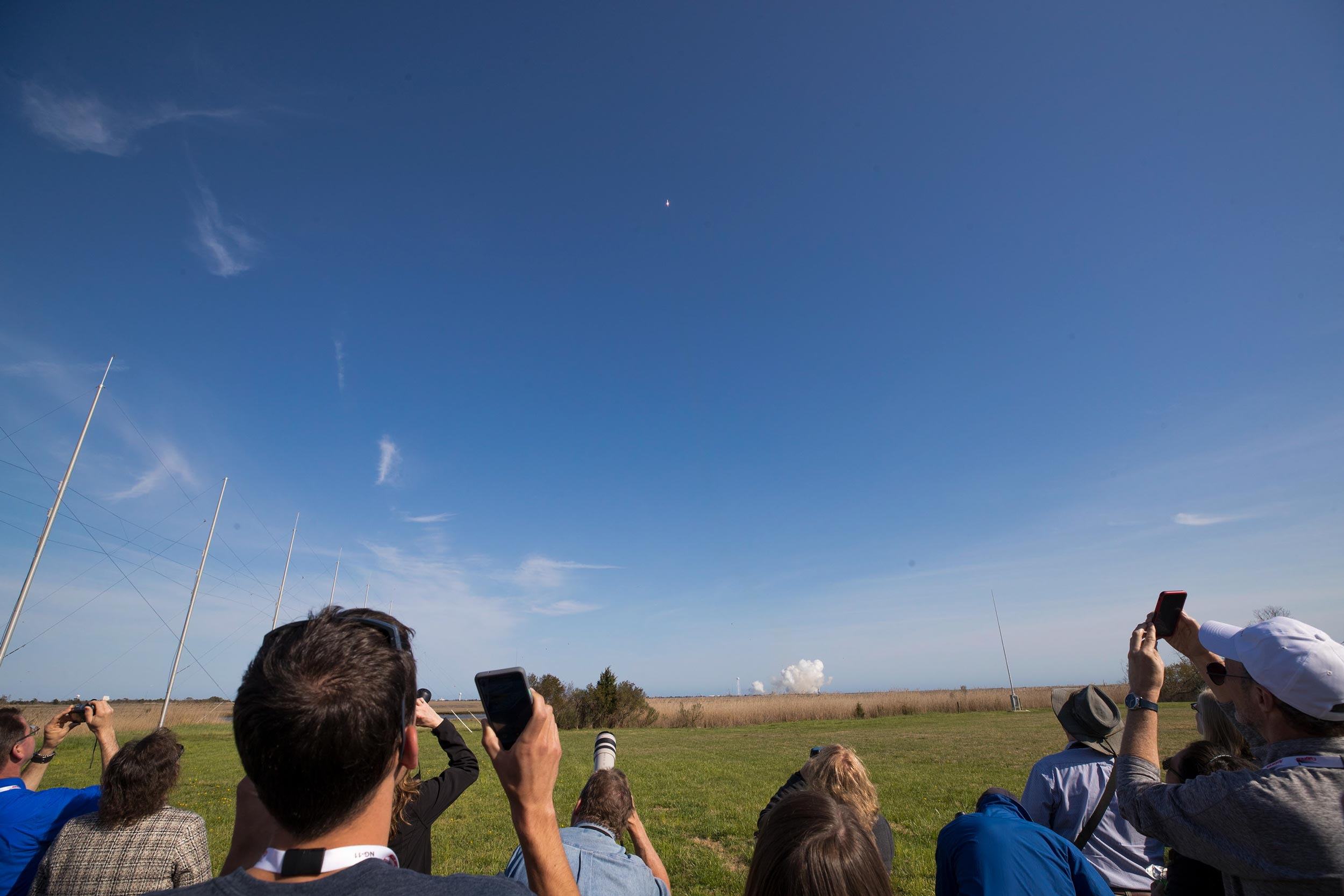 UVA students and others watch as the rocket carries the CubeSat payload into space.