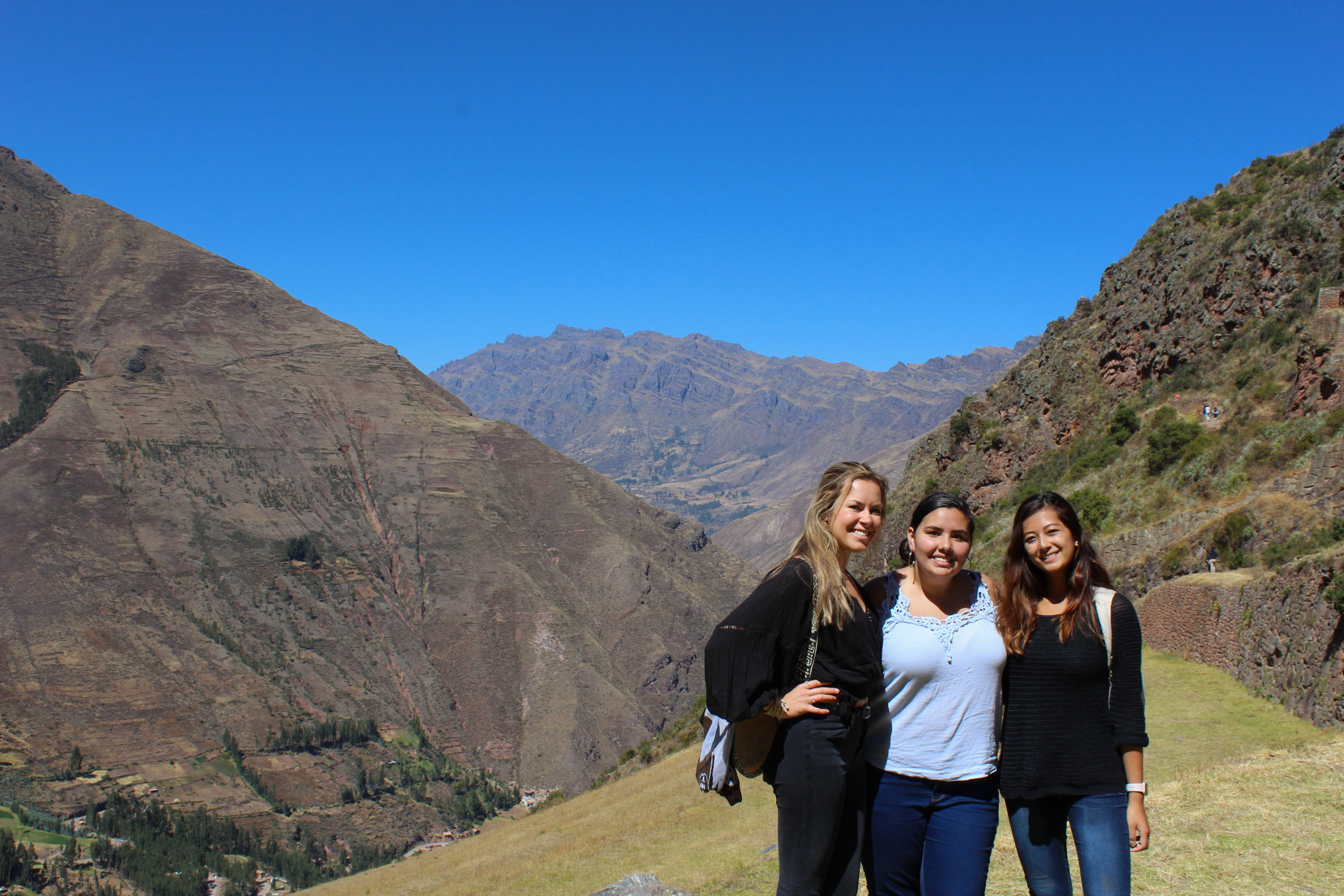 Left to right, Oyler, Annelise Mrianda and Joshi in the sacred valley of the Incas at an archaeological site called Pisac.