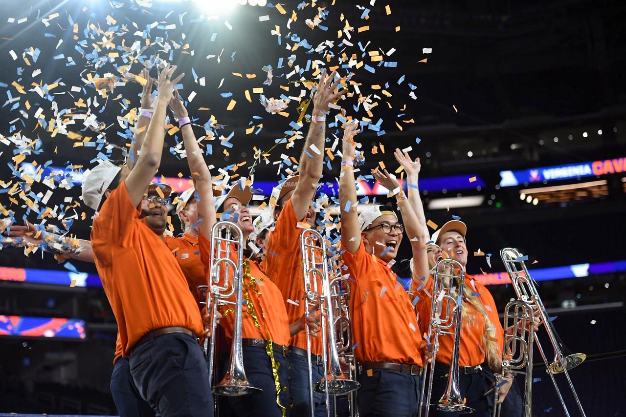 Shim, center, relished the moment with his fellow trombonists as the confetti fell in Minneapolis after the UVA men's basketball team's NCAA title win.