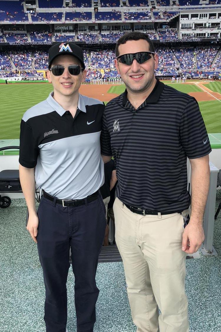 UVA alumni Dawson Friedland, left, and Myles Lewis work in the Miami Marlins' analytics department.
