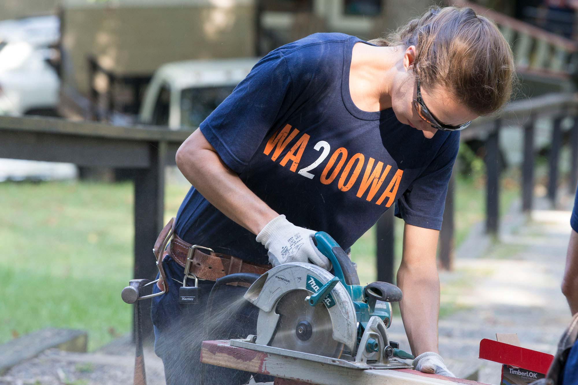 Anne Tufts, a carpenter apprentice at Facilities Management, cuts a frame for a doorway at Camp Holiday Trails.