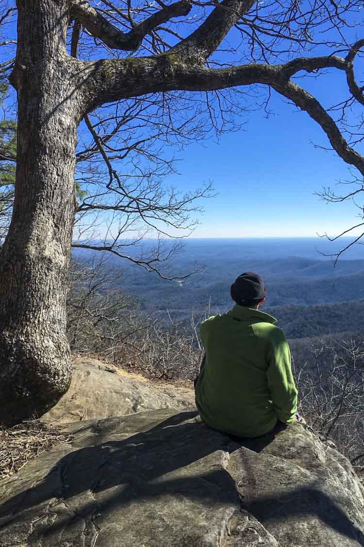 Underhill, shown here at a scenic overlook on the Appalachian Trail, said hiking helped him realize he needed professional counseling.
