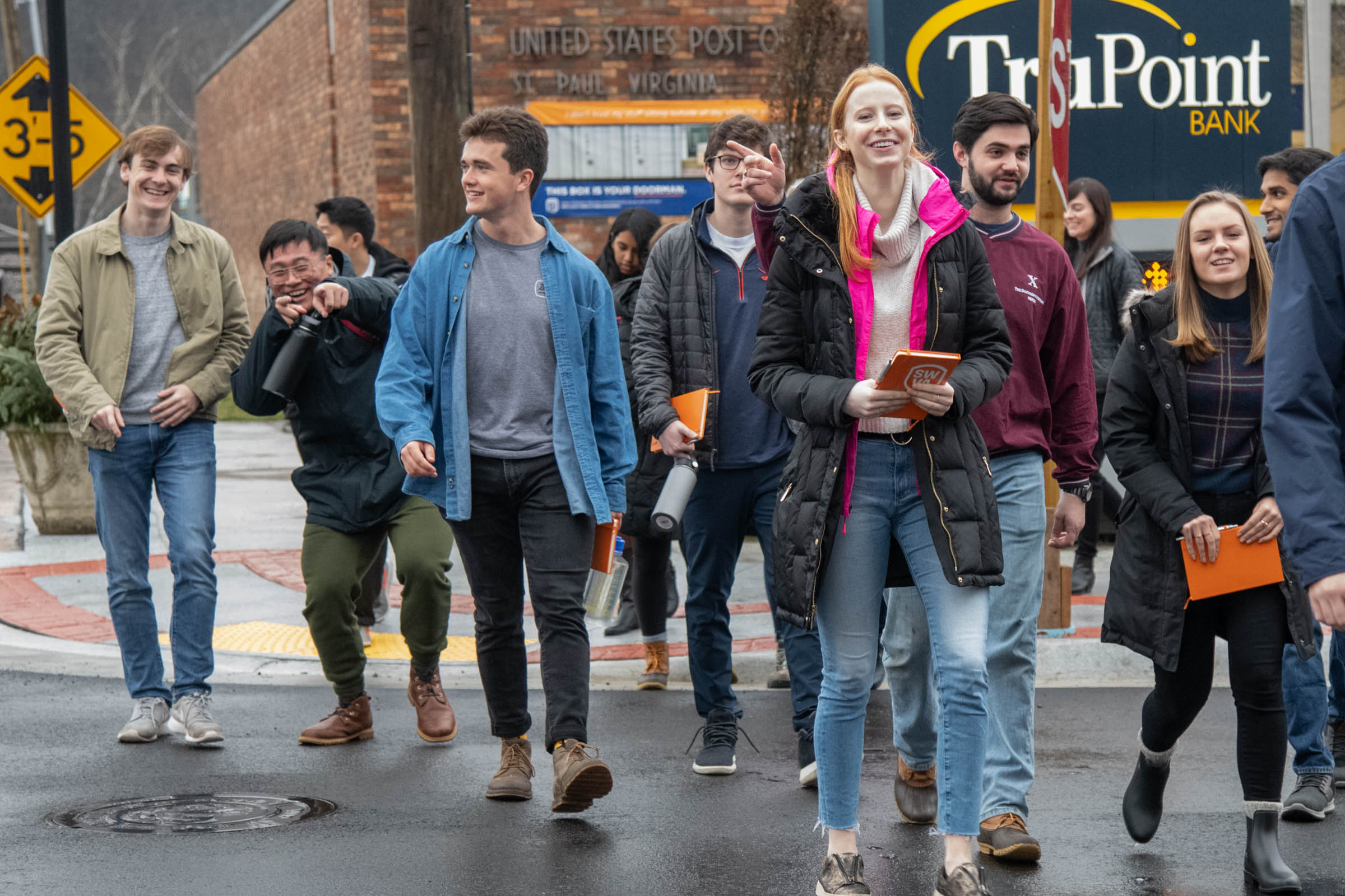 Students in Mahoney's J-Term class walk in downtown St. Paul, Virginia. Behind them is the newly opened Western Front Hotel, which was a historic building restored through impact investing.