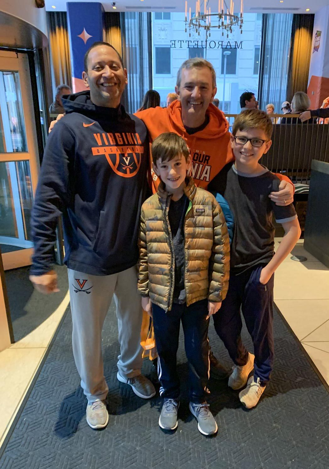 Duffy and his sons with Mark Jerome, left – UVA star Ty Jerome's father and the Duffy boys' youth basketball coach. (Contributed photo)