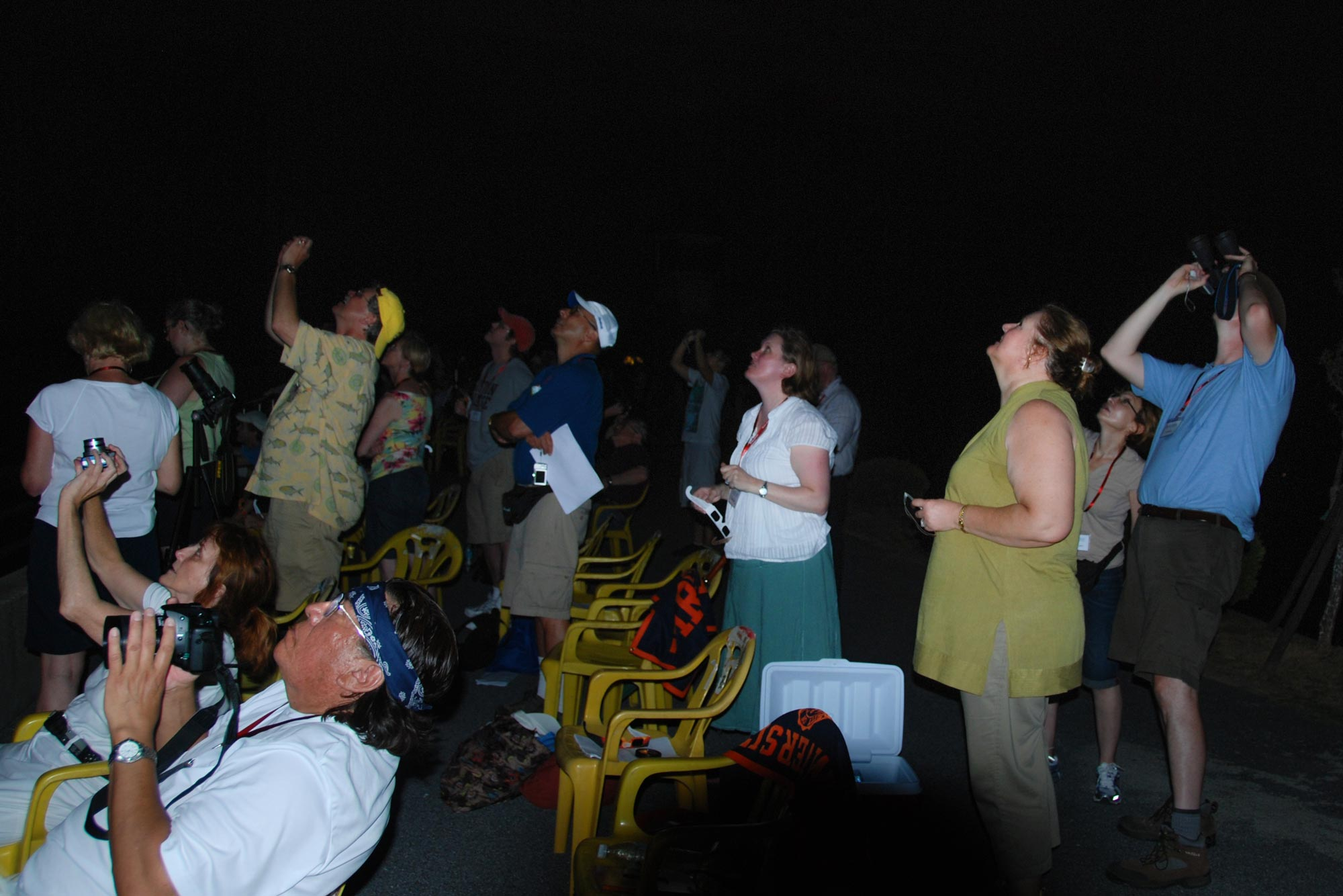 Participants on a Cavalier Travels trip to China in 2009 view a solar eclipse during totality, the brief moments when special viewing glasses are not needed. (Photo by Ed Murphy)