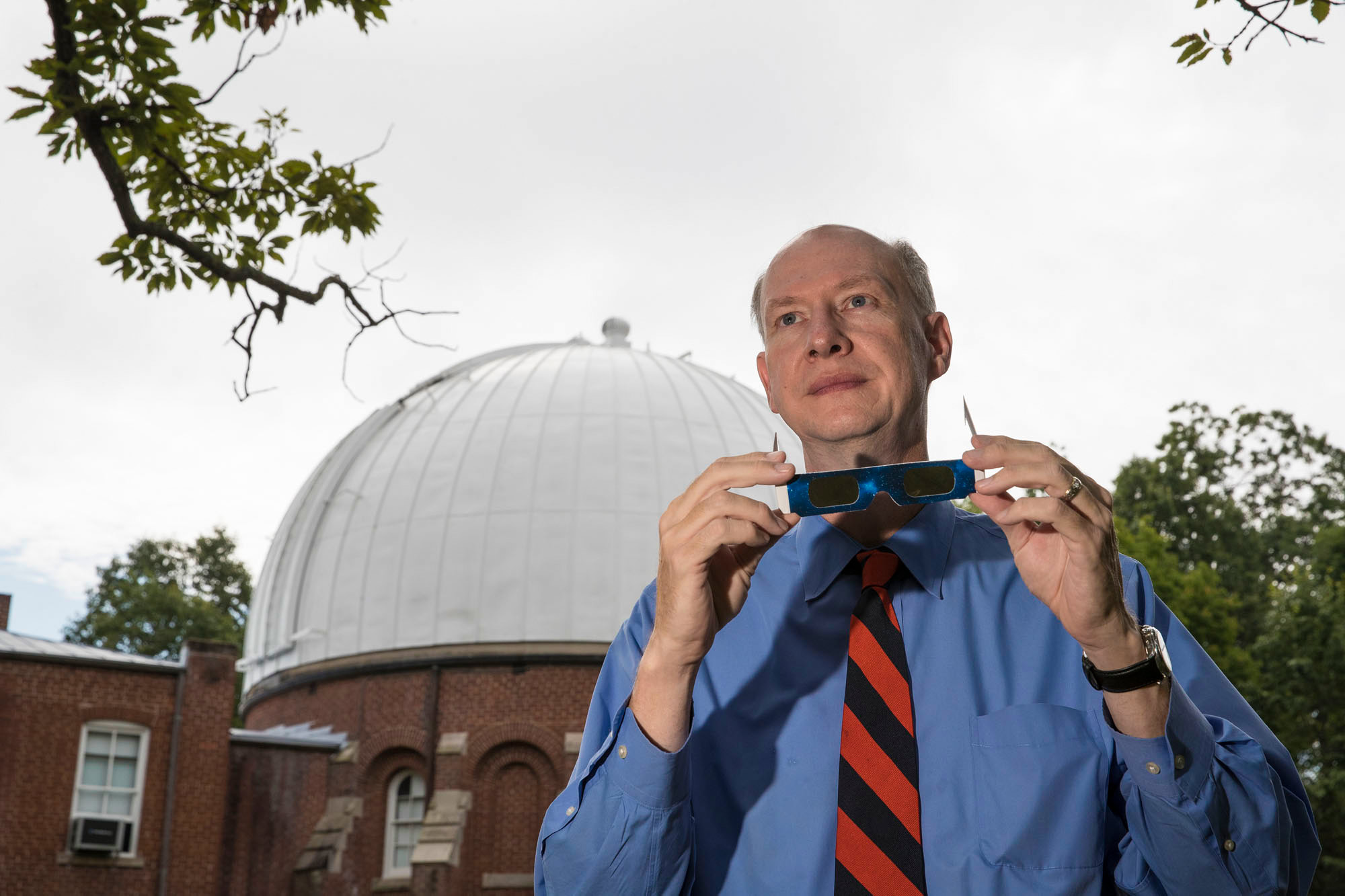 Astronomer Ed Murphy with a pair of certified solar eclipse glasses. On Monday, he will serve as a scientific consultant at a public viewing event in South Carolina.