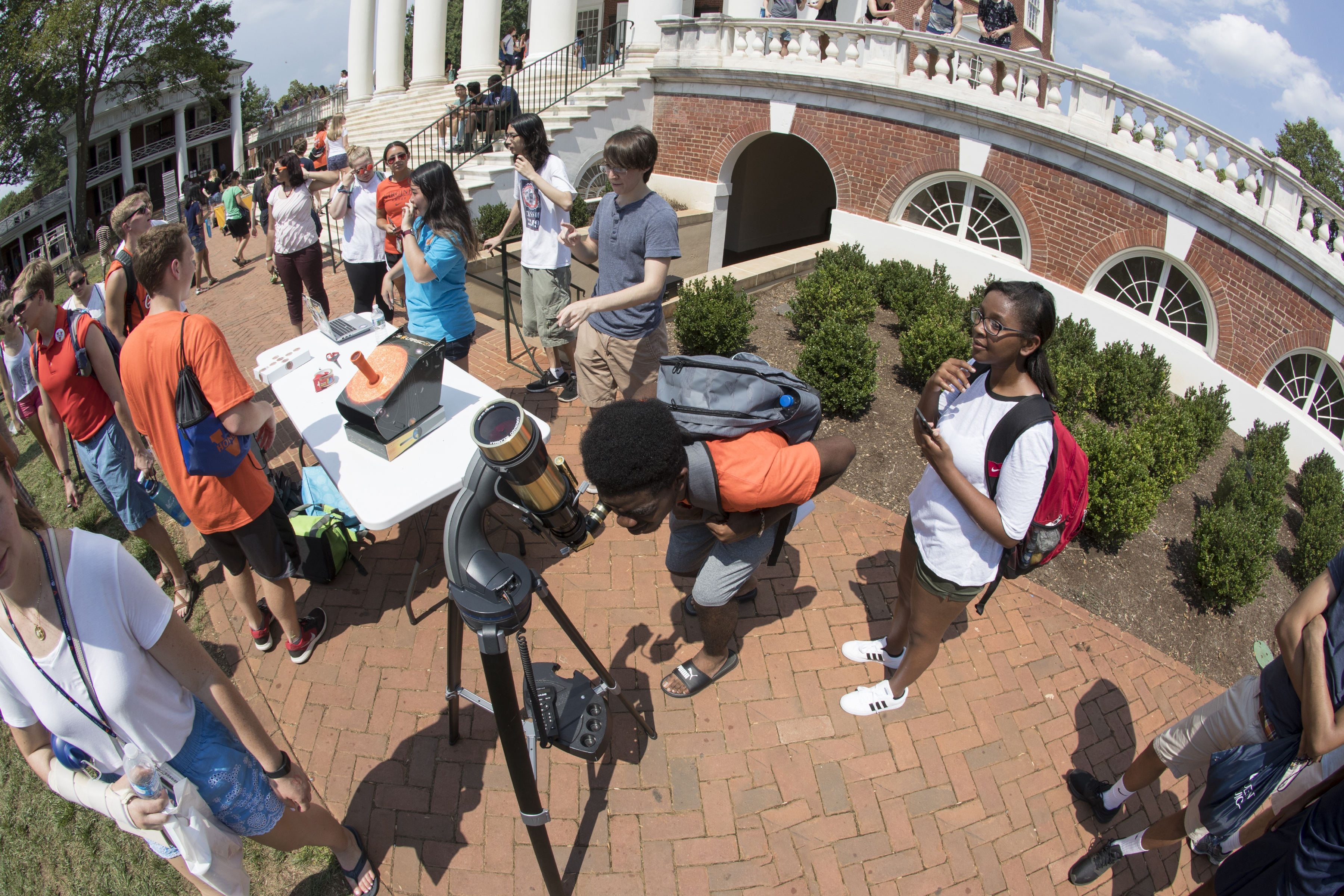 First-year student Emmanuel Ndumbe peers through the H-alpha telescope. (Photo by Dan Addison, University Communications)