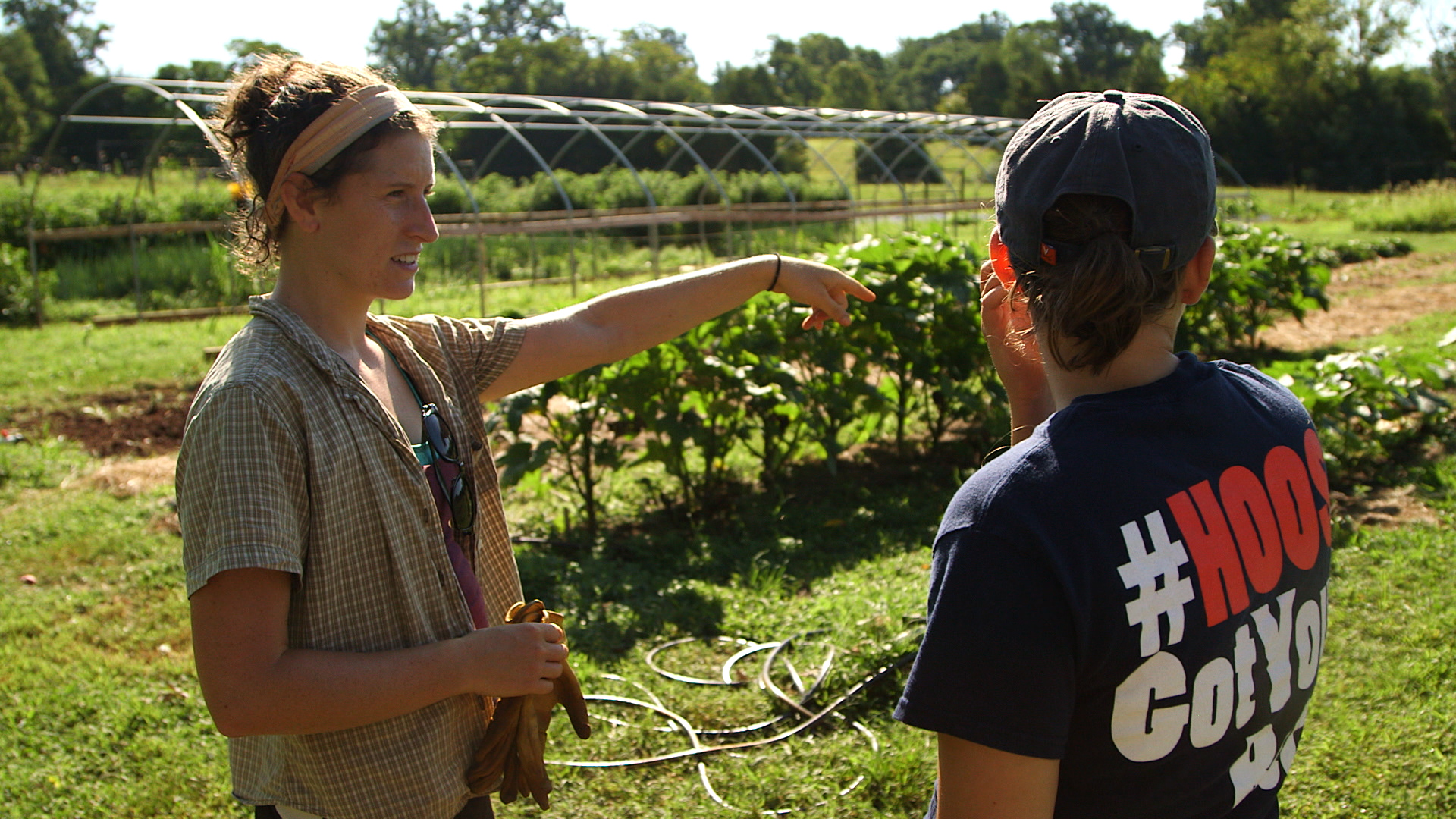 Emily Salle, who manages the Morven Kitchen Garden, talks with a student volunteer.