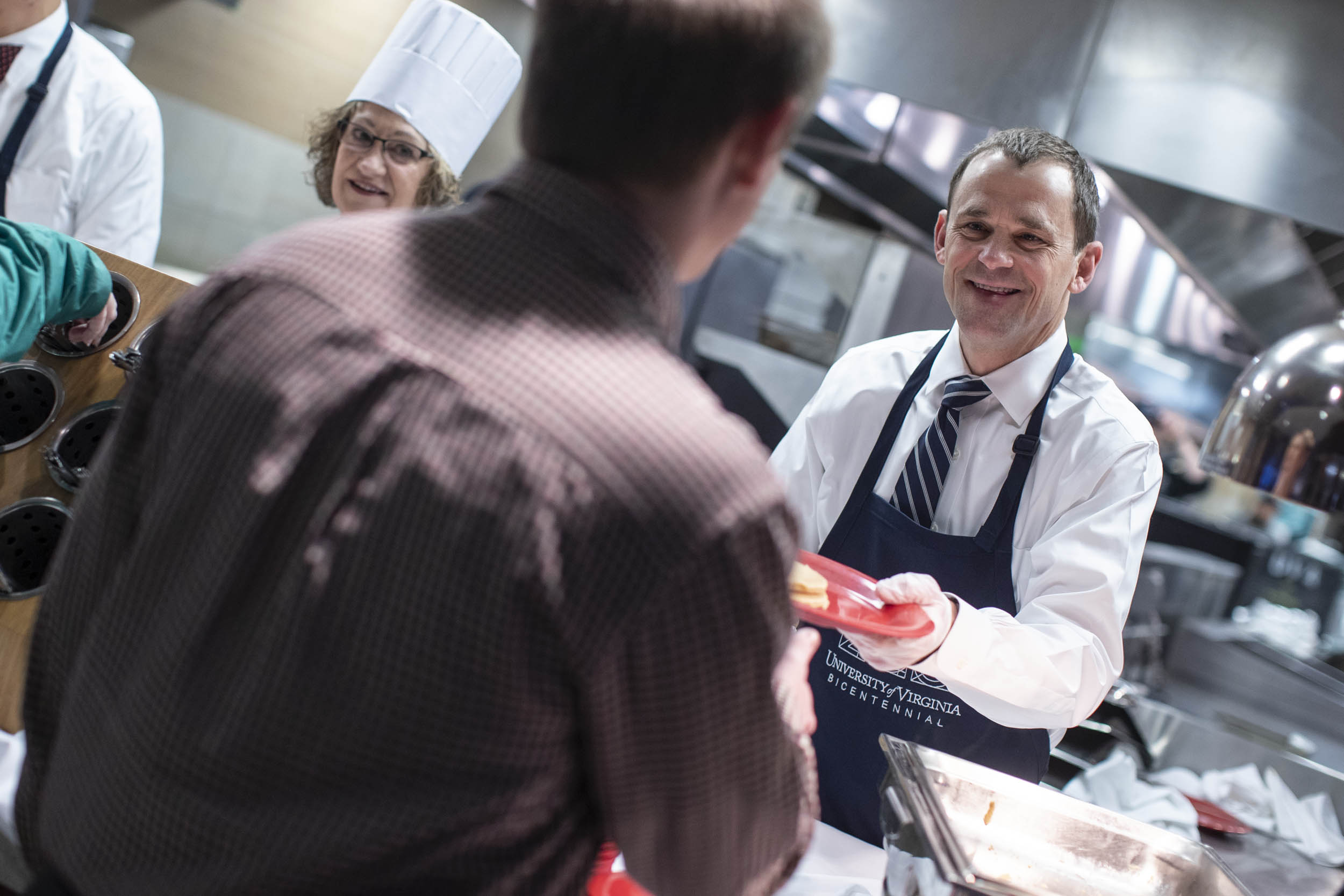 President Jim Ryan donned an apron to serve employees at the annual staff appreciation breakfast Tuesday morning.