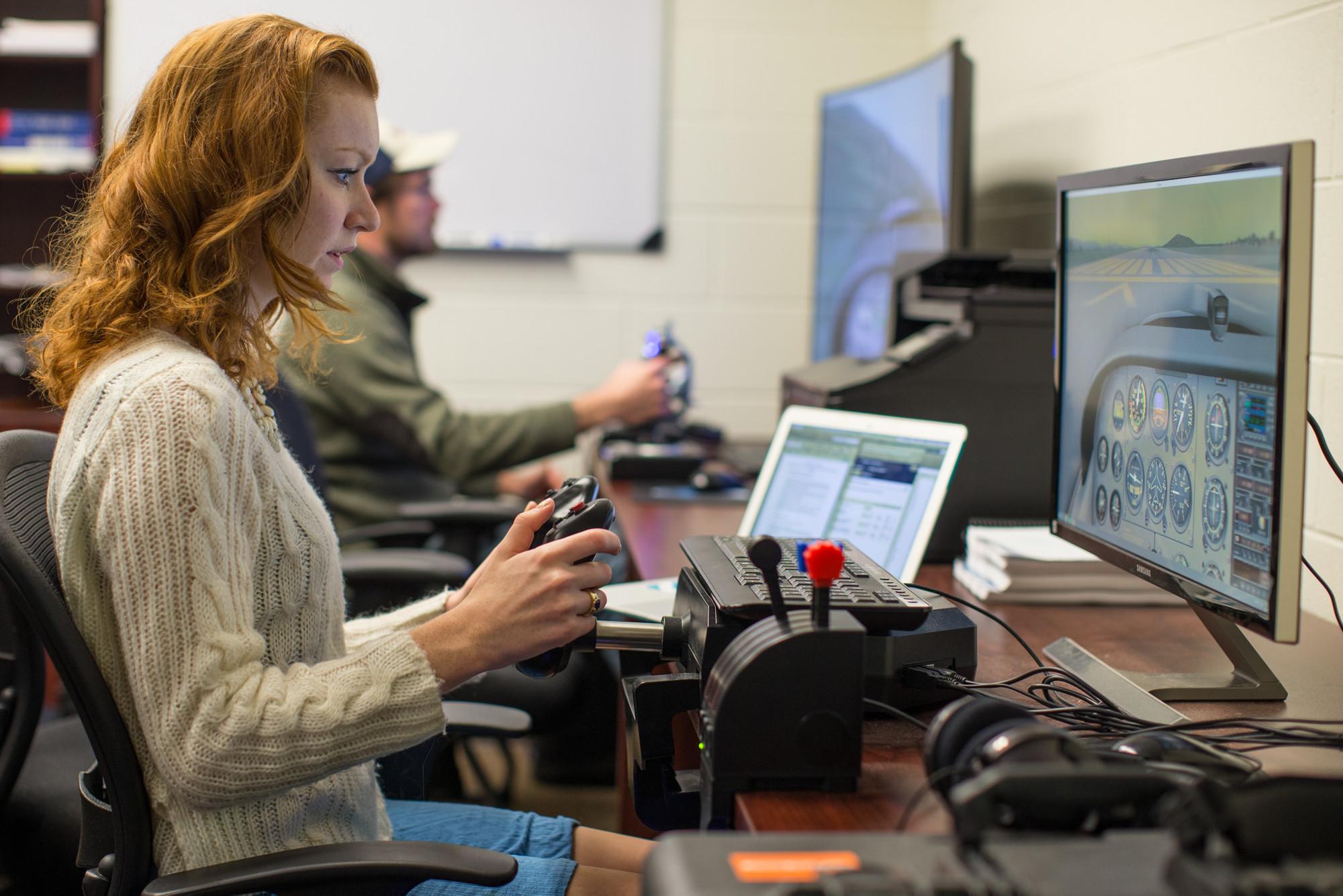 Haley Kosheff uses a computer-based flight simulator.