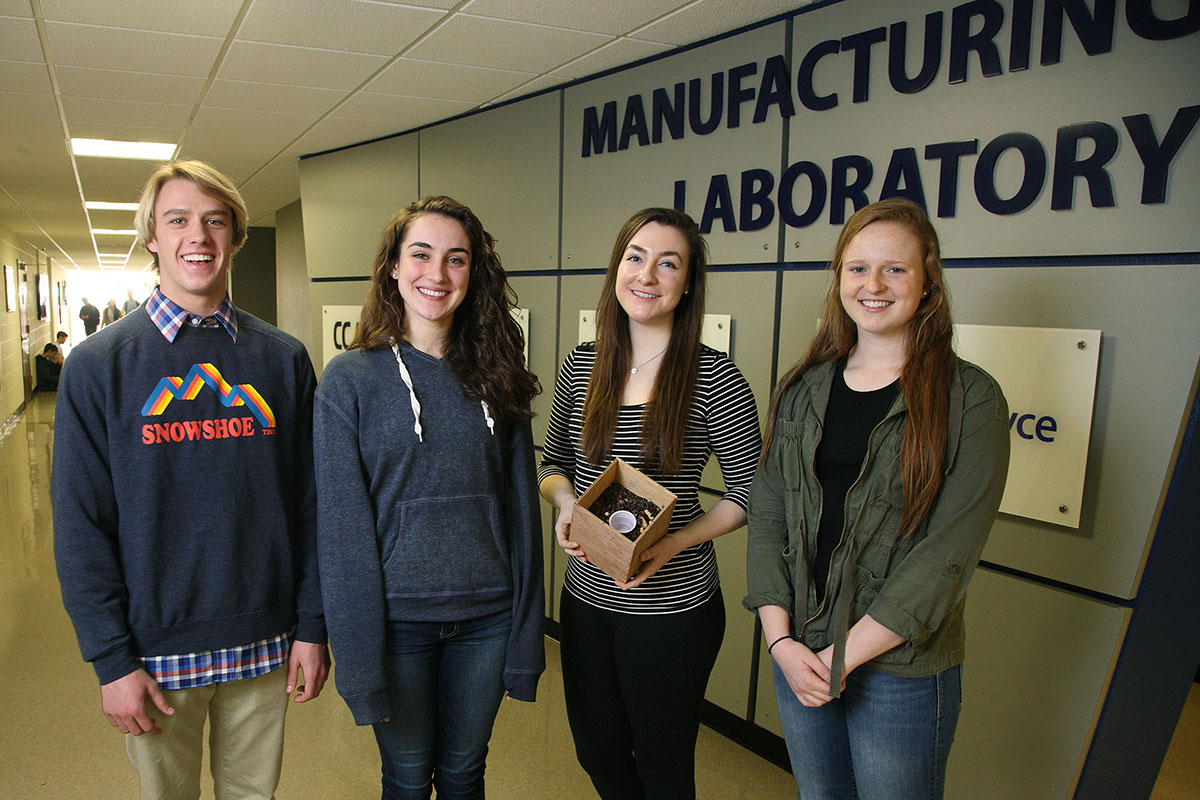 "From left, Justin Pender, Audrey Fifer, Caroline Kinsella and Morgan Patterson hold their mushroom spore home insulation, their project for their ""Introduction to Engineering"" course."