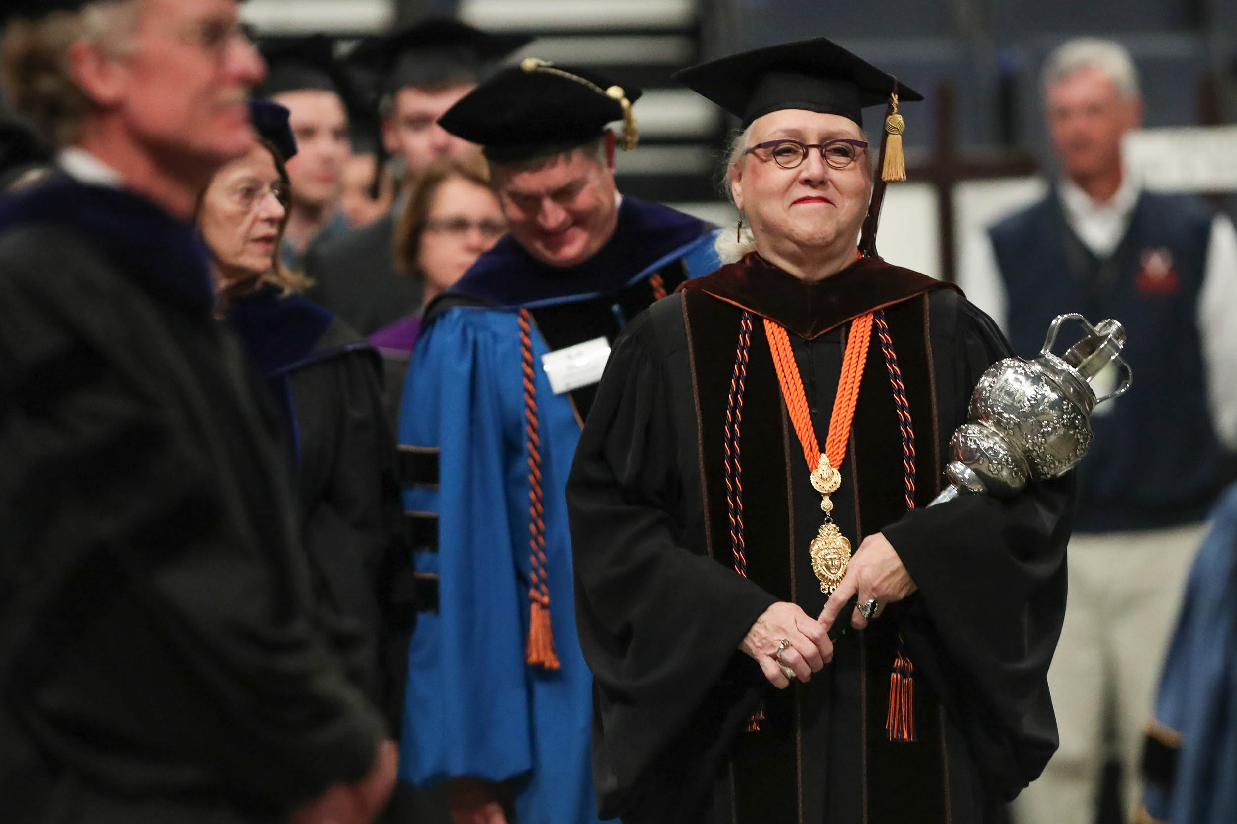 Gweneth West, a drama professor, leads the academic procession at Friday's Fall Convocation.
