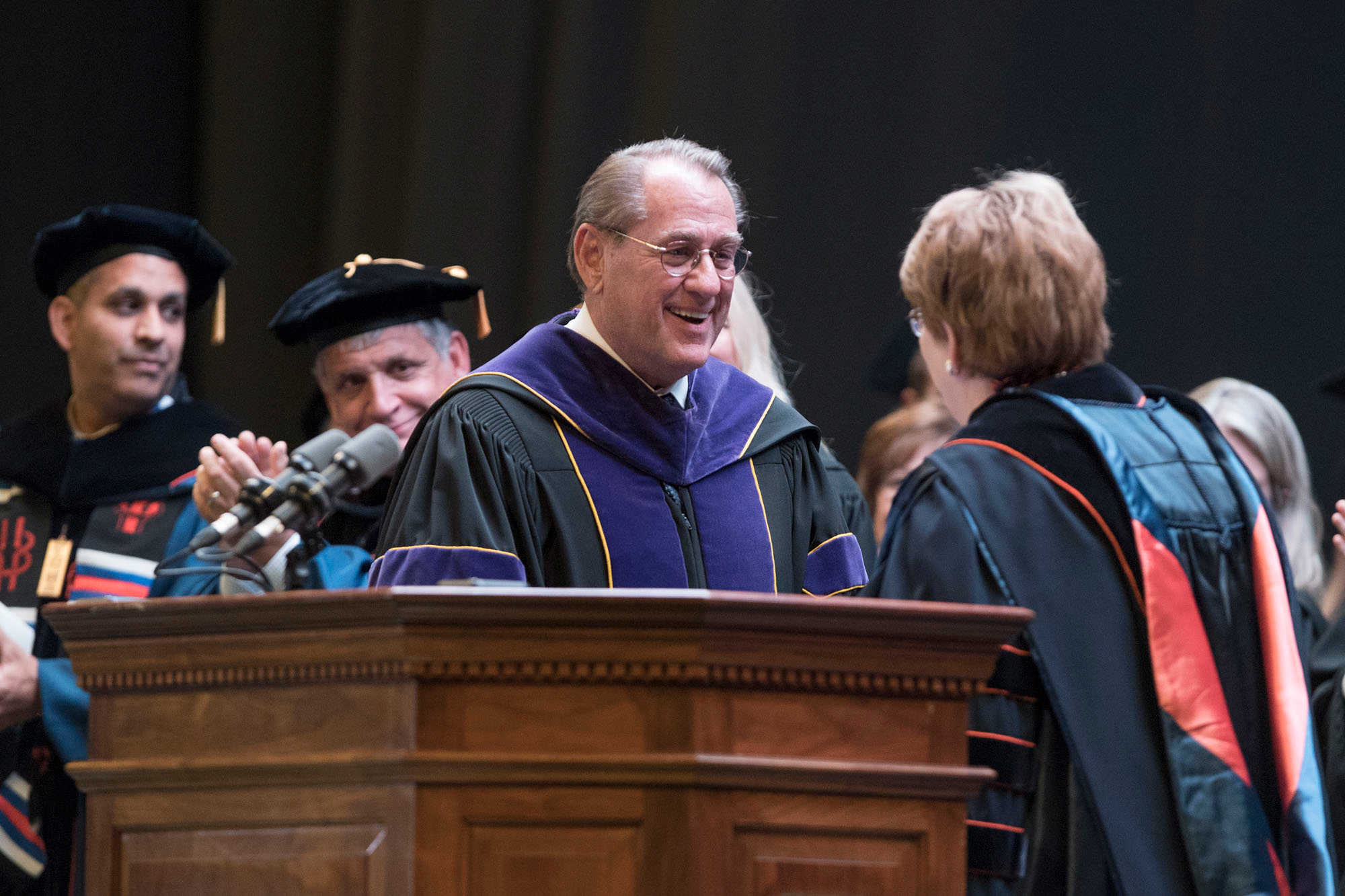 Former Law School Dean John Jeffries shakes hands with University President Teresa A. Sullivan after receiving the Thomas Jefferson Award for Scholarship.