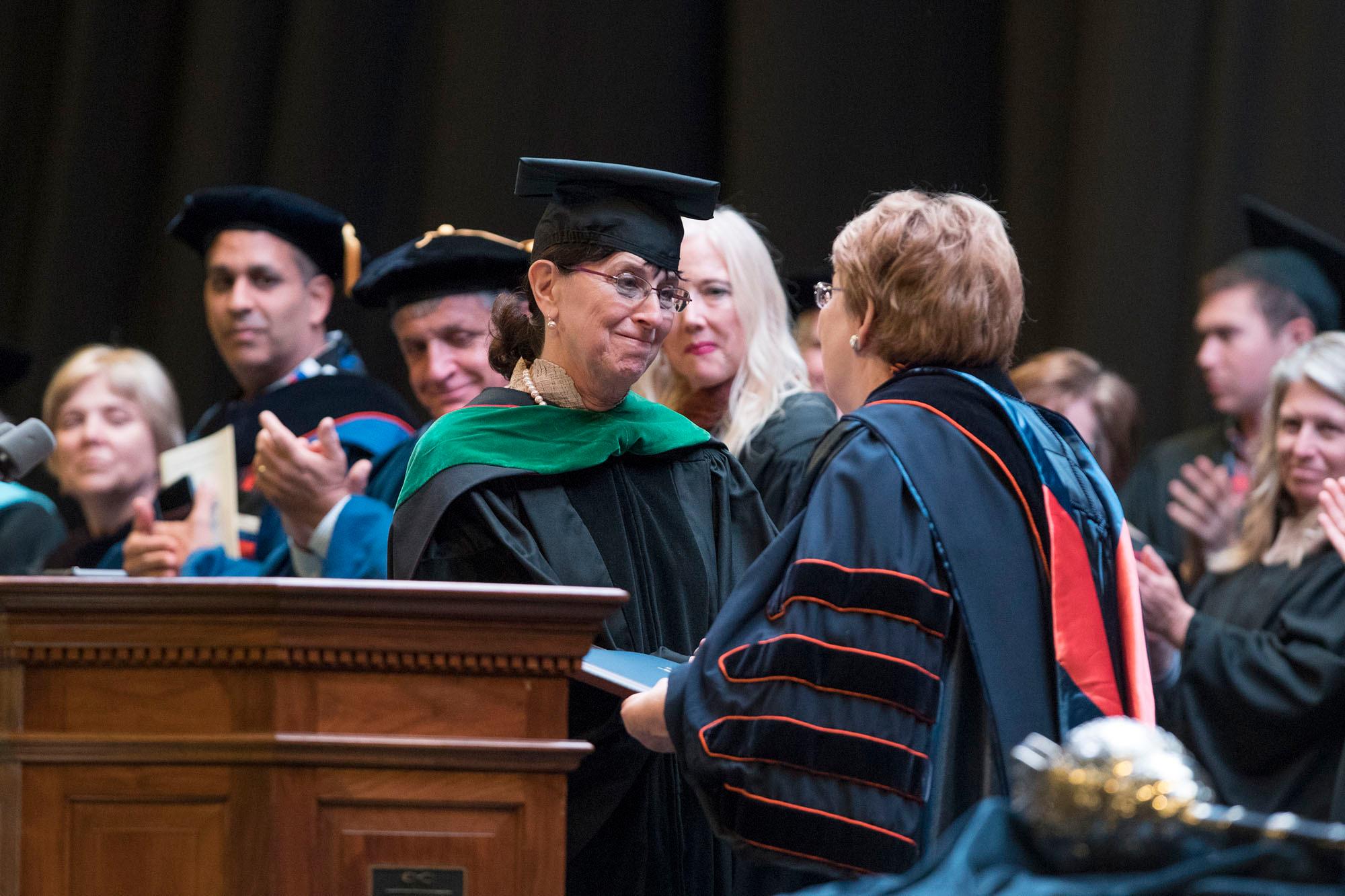 Dr. Karen S. Rheuban, director of the UVA Center for Telehealth, thanks University President Teresa A. Sullivan after receiving the Thomas Jefferson Award for Service.
