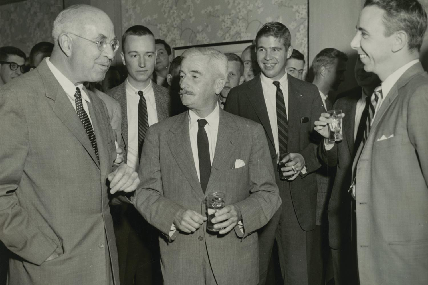 William Faulkner, center, and John Dos Passos, left, at a 1957 reception following an open Jefferson Society lecture delivered by Dos Passos. Faulkner was writer-in-residence at UVA from 1957-58.