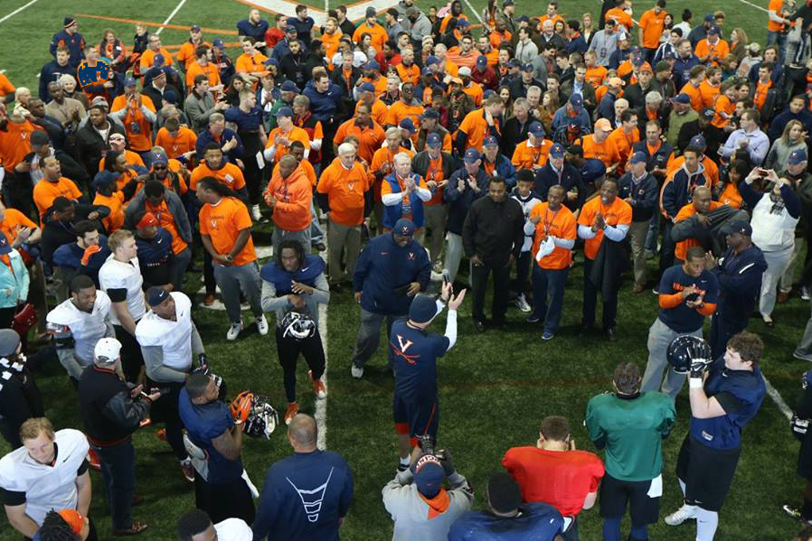 At Mendenhall's invitation, hundreds of former UVA football players attended a practice Saturday, curious to see the new staff at work.