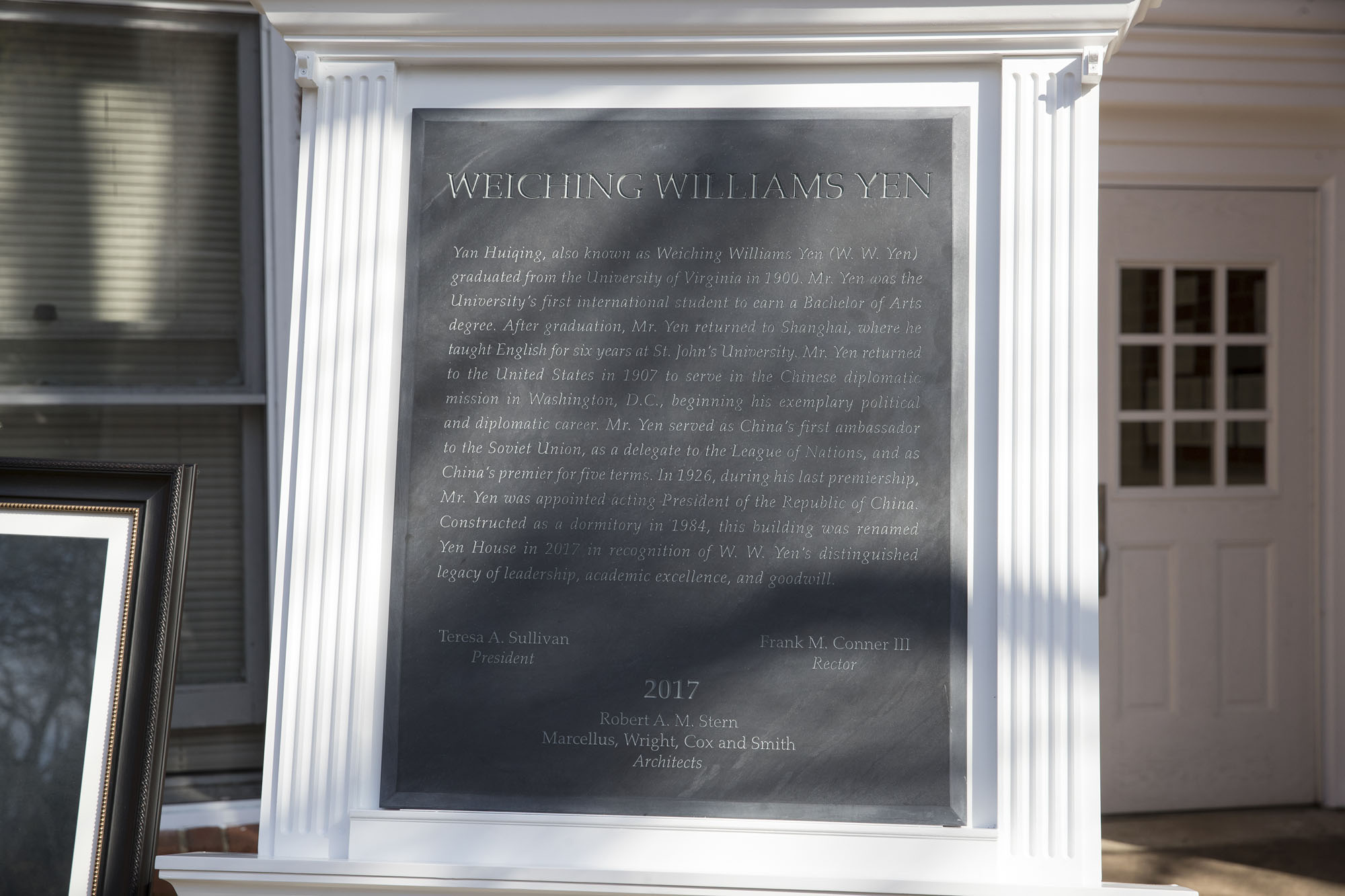 The plaque is inscribed with the history of W. W. Yen. (Photo by Dan Addison, University Communications)