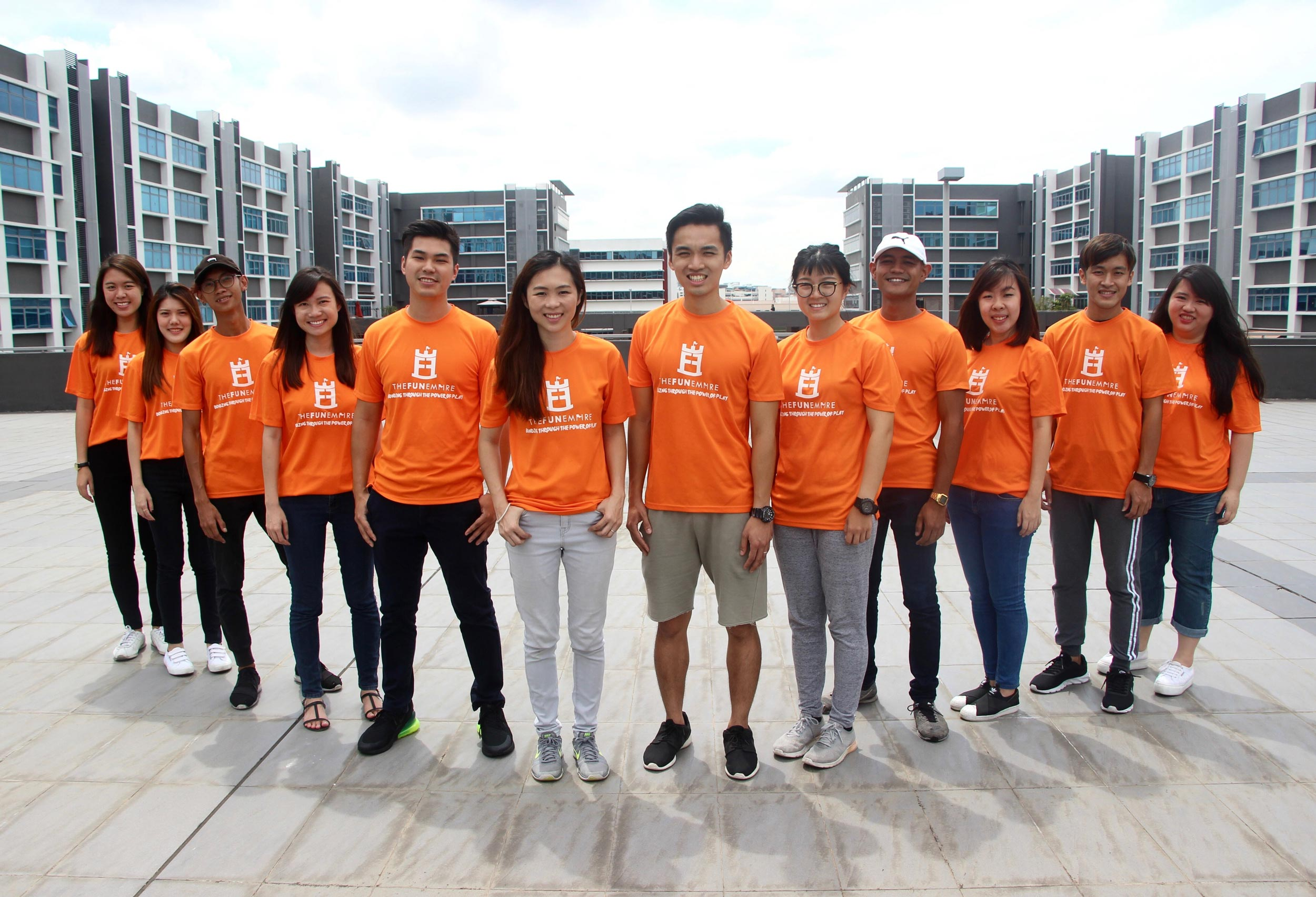 "Alumnus Ryan Ho, center, with his Fun Empire team. Ho was named to Forbes ""30 Under 30 Asia"" list this year."
