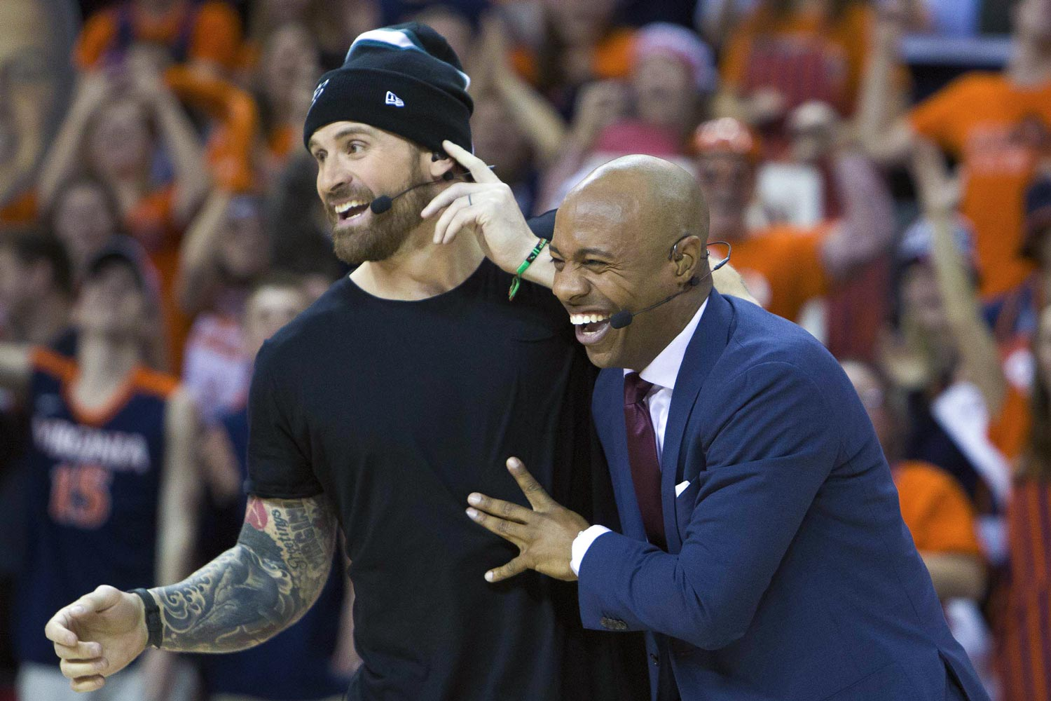 "Long, a frequent visitor to Grounds, laughs with Jay Wiliams during ESPN's ""College GameDay"" broadcast in February from John Paul Jones Arena."