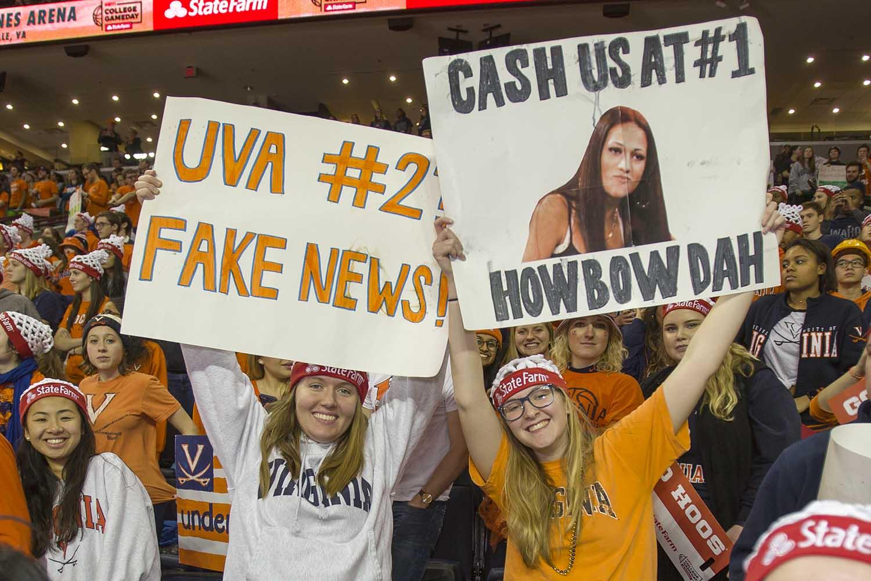 """Sign reading """"UVA #2 Fake news"""" and """"Cash us at #1"""""""