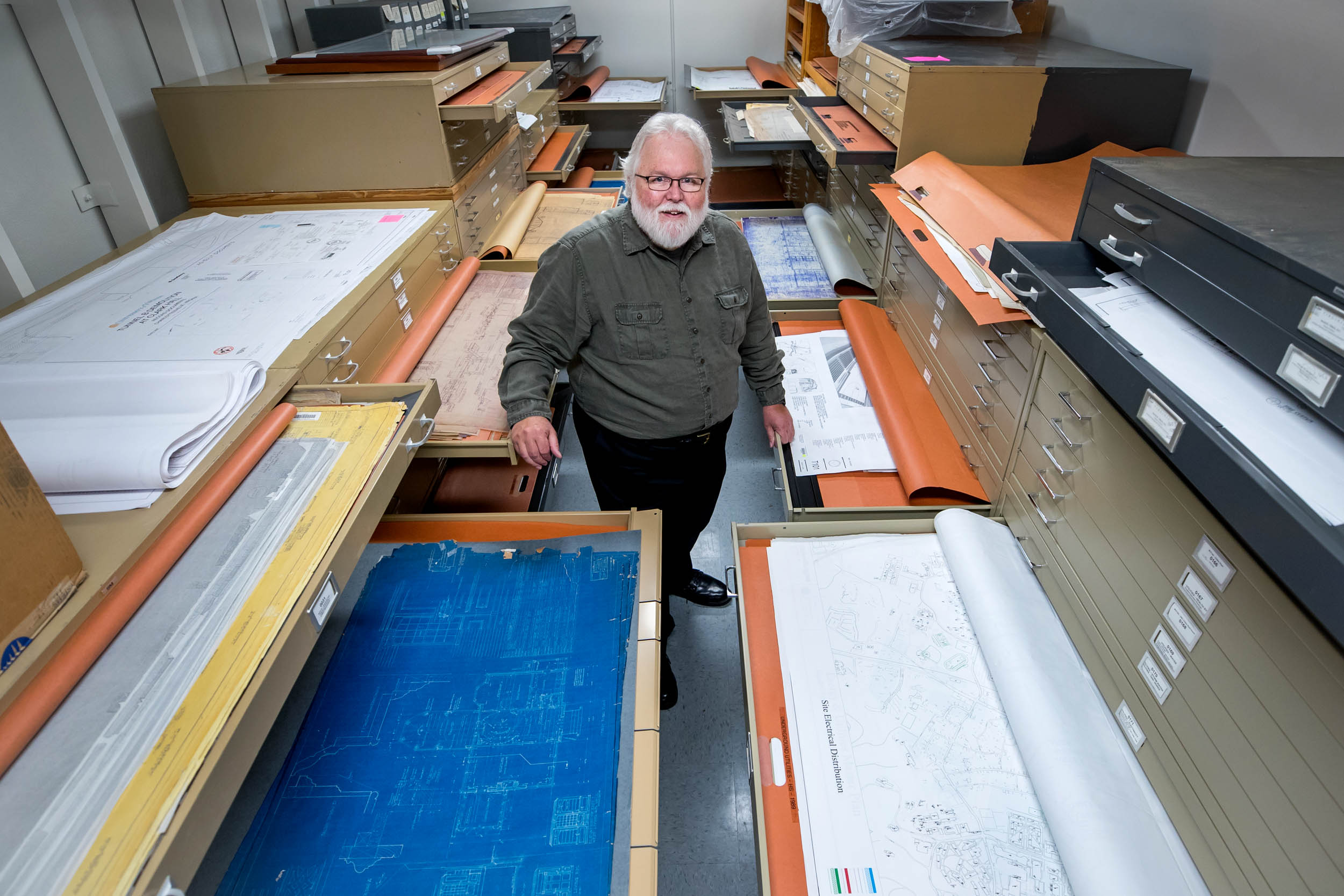 Garth Anderson manages an extensive database of building designs that includes hundreds of years of building plans. (Photo by Sanjay Suchak, University Communications)