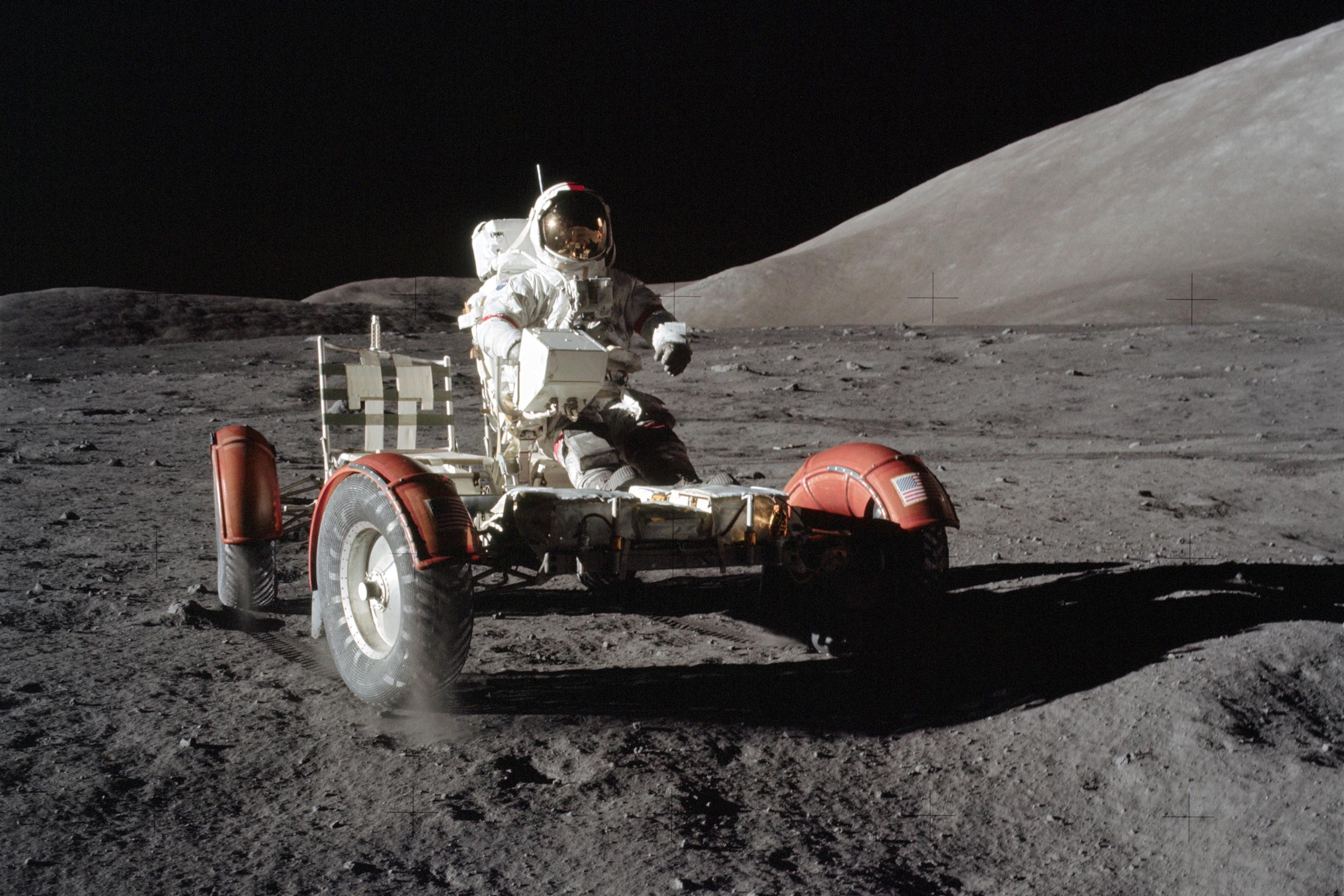 Cernan operates the lunar rover vehicle during a traverse of the lunar surface during the Apollo 17 mission to the moon. (NASA photo)
