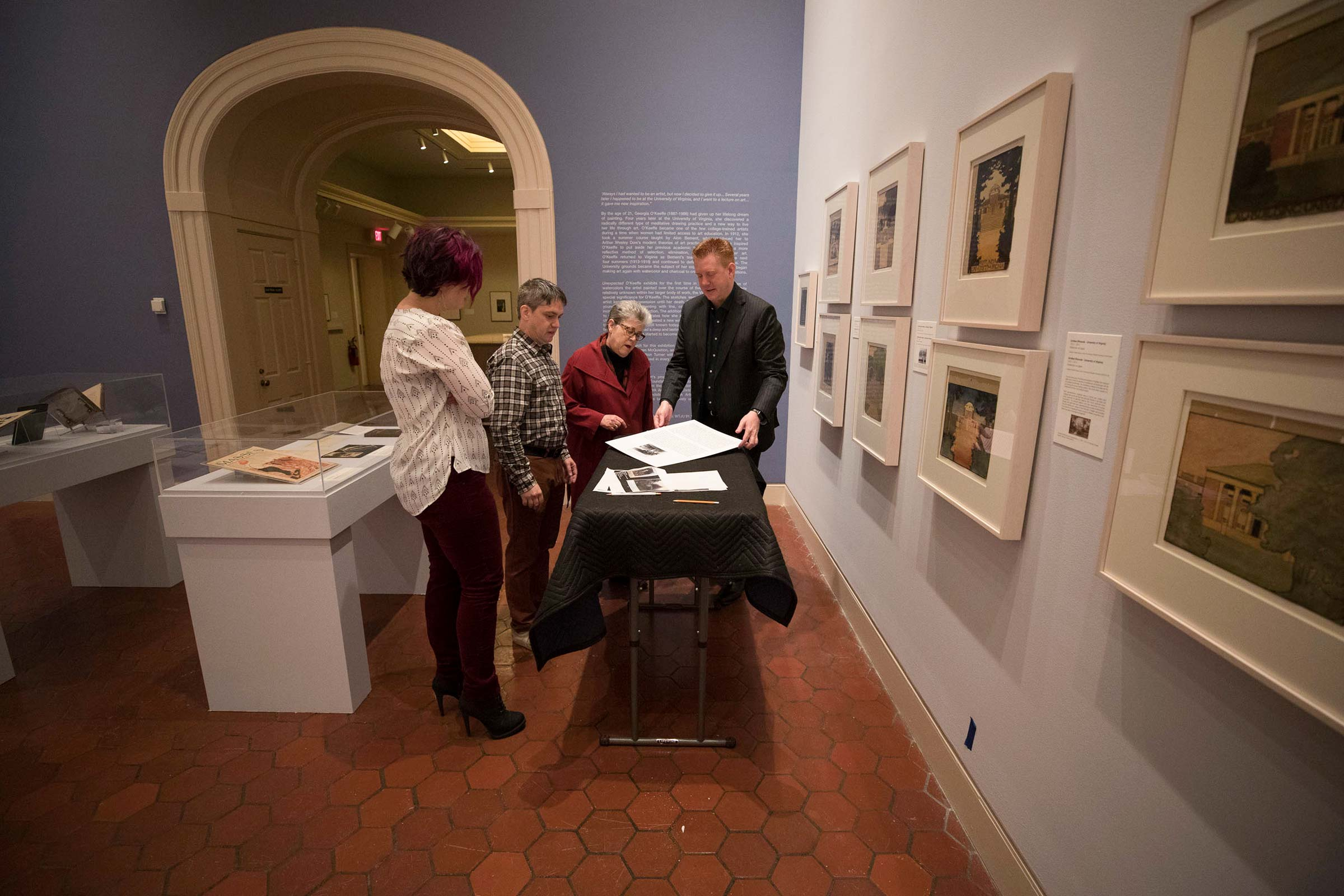 Left to right, Ph.D. student Meaghan Walsh, recent graduate Jonathan Chance, art history professor Elizabeth Turner and Fralin director Matthew McLendon prepare the soon-to-be-opened exhibition.