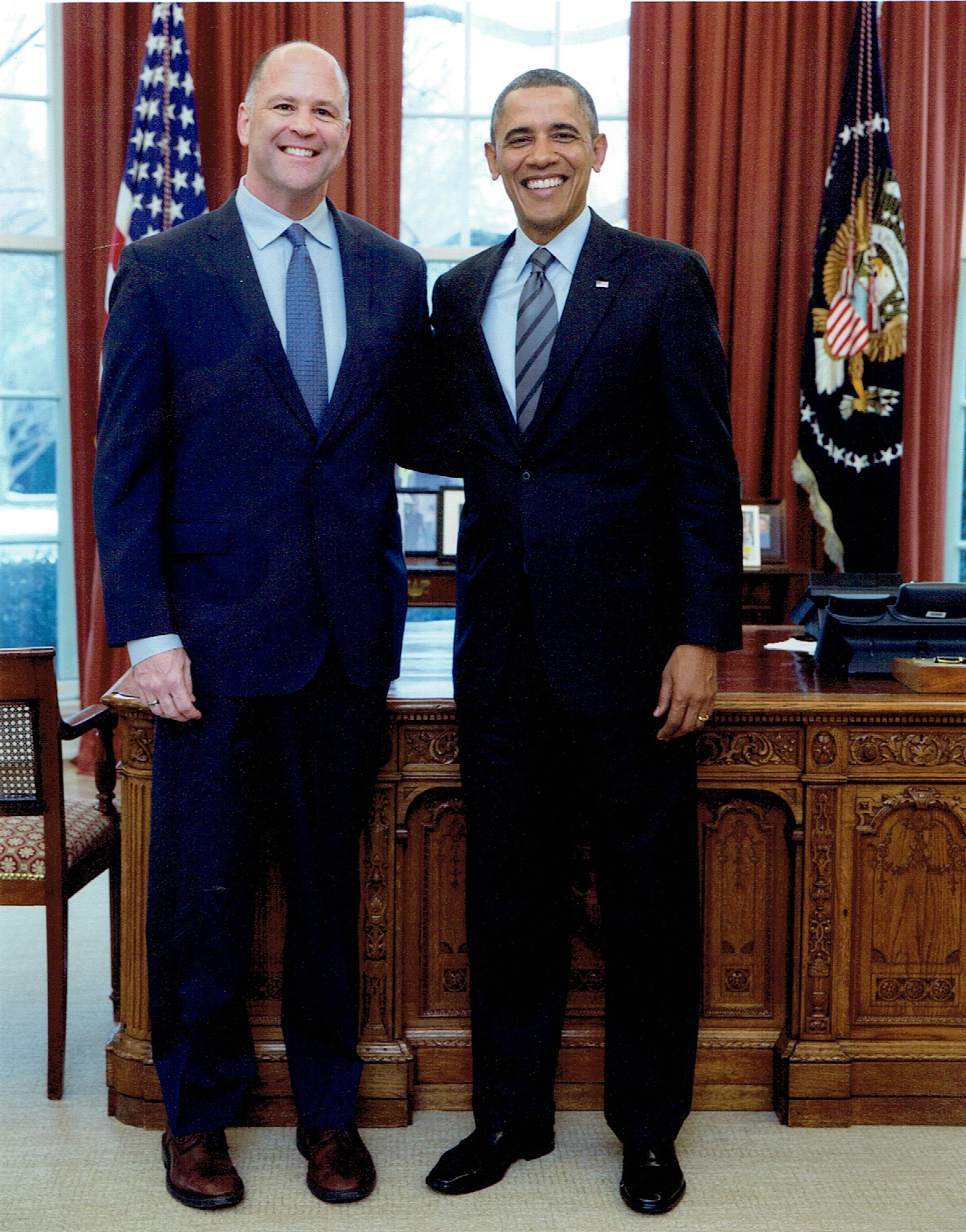 President Obama congratulates former Deputy Assistant Secretary Jerry White in the Oval Office for helping launch the new Bureau of Conflict and Stabilization Operations in 2014.