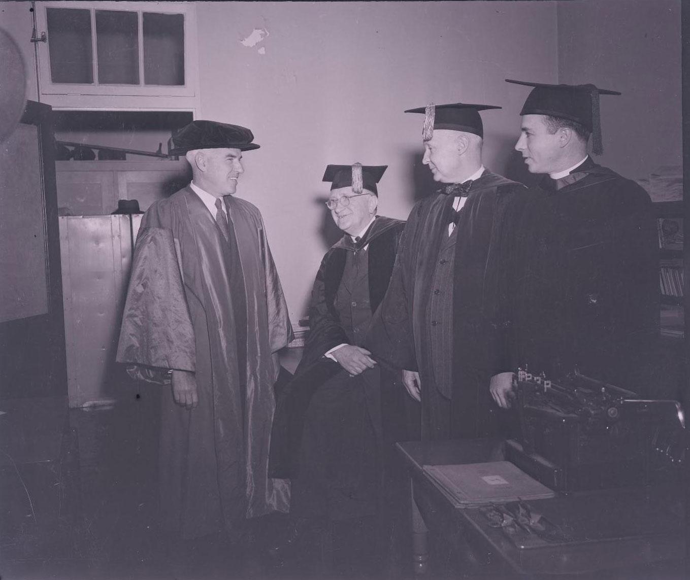 Rector Stettinius, left, in academic regalia on the Grounds at UVA.