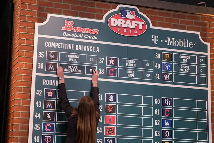 While working as an intern in the Office of the Commissioner, Alvarez placed players' names on the board as they were drafted. Some of them were UVA players with whom she had worked . (Photo courtesy of Haley Alvarez)