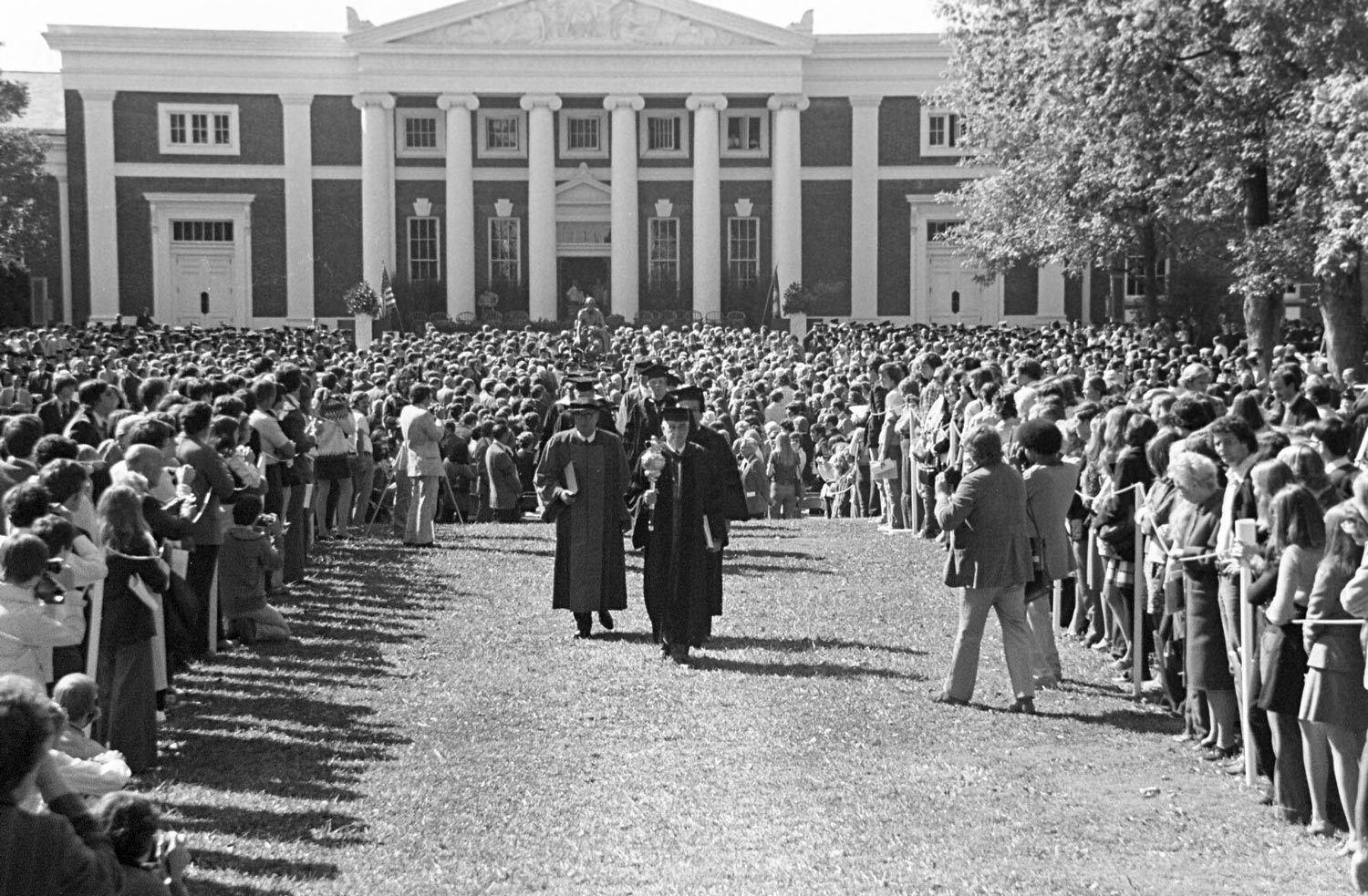The inauguration procession for President Frank L. Hereford, heads back up the Lawn following his swearing-in.