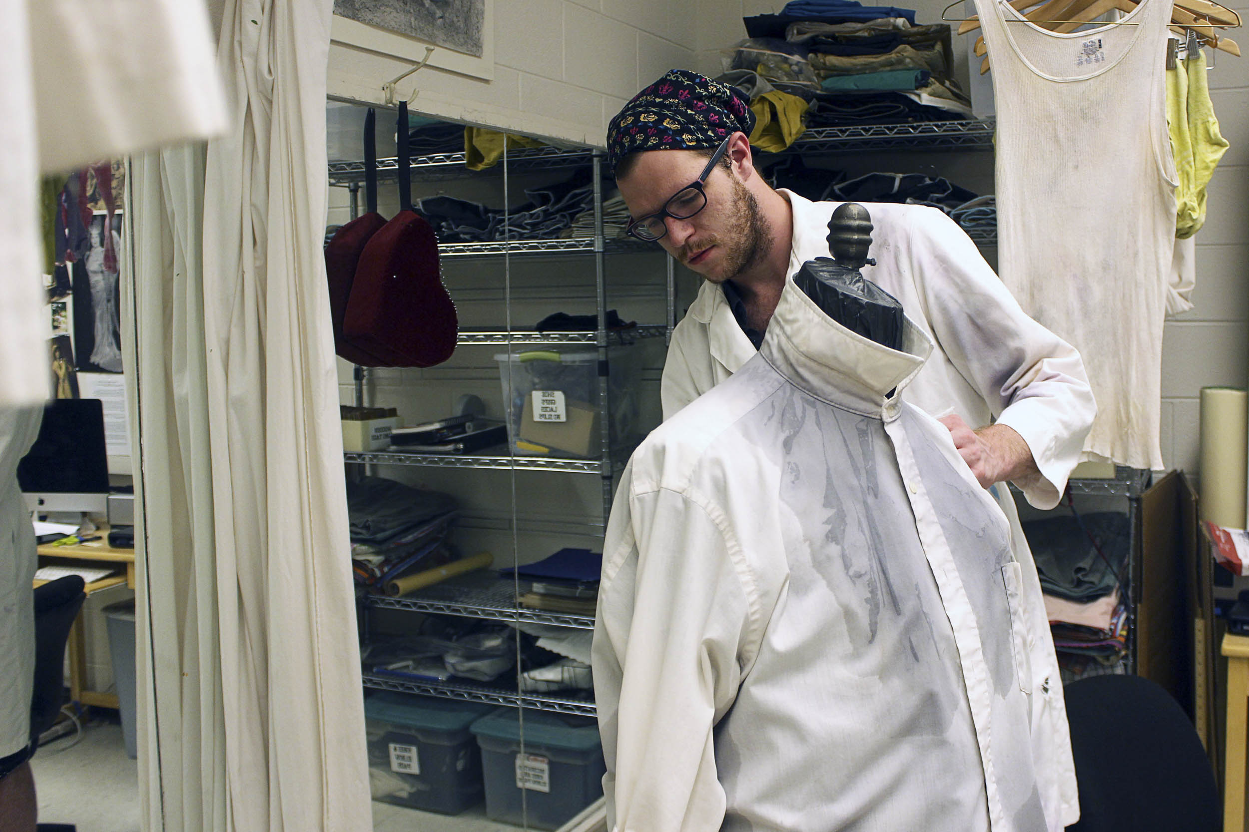 """Wardrobe supervisor Joseph Musgrove adds fake sweat to a costume piece for Heritage's production of """"The Odd Couple."""""""