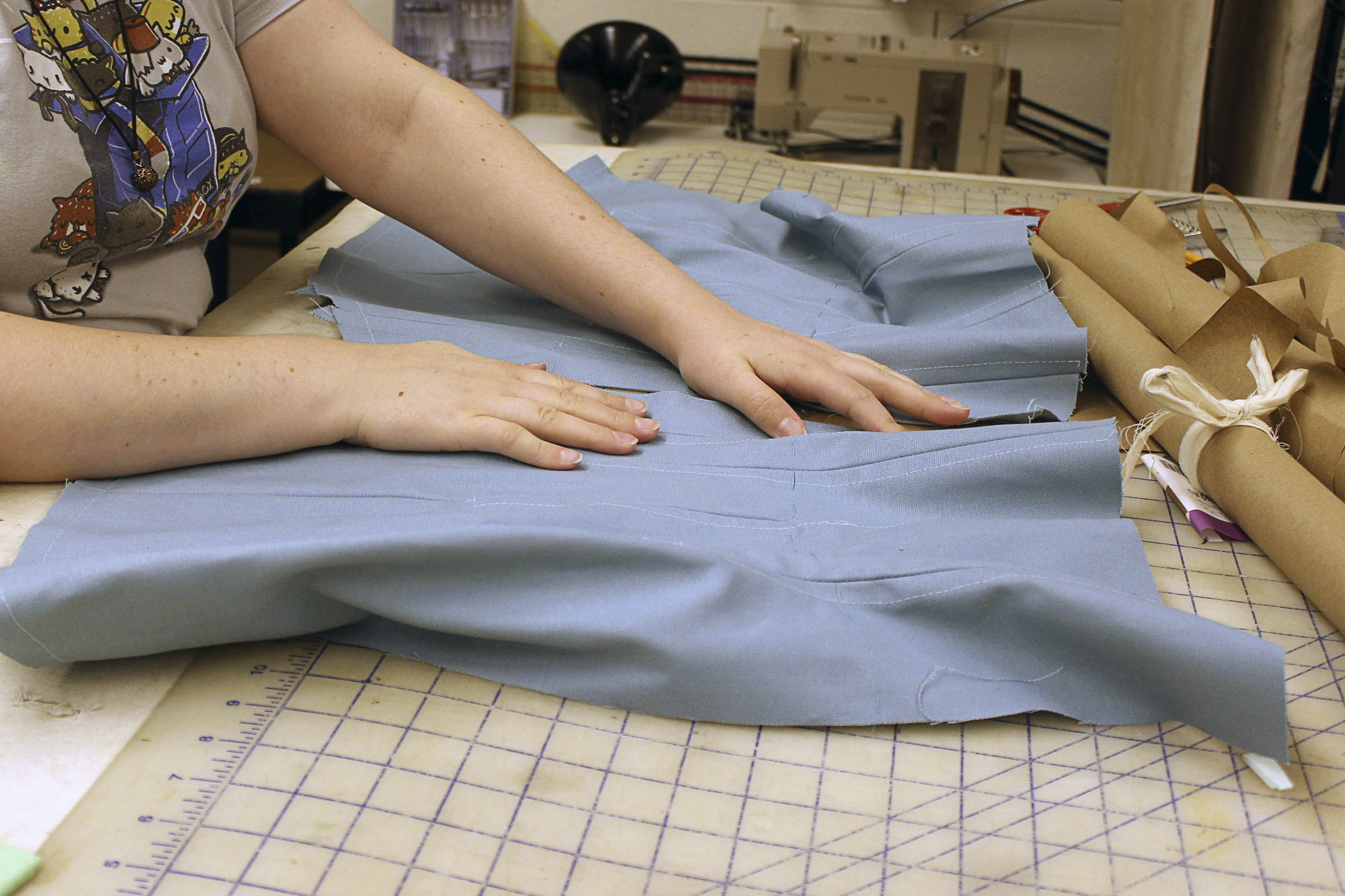 Cutter/draper and first hand Caitlin Leyden lays out an unfinished corset.