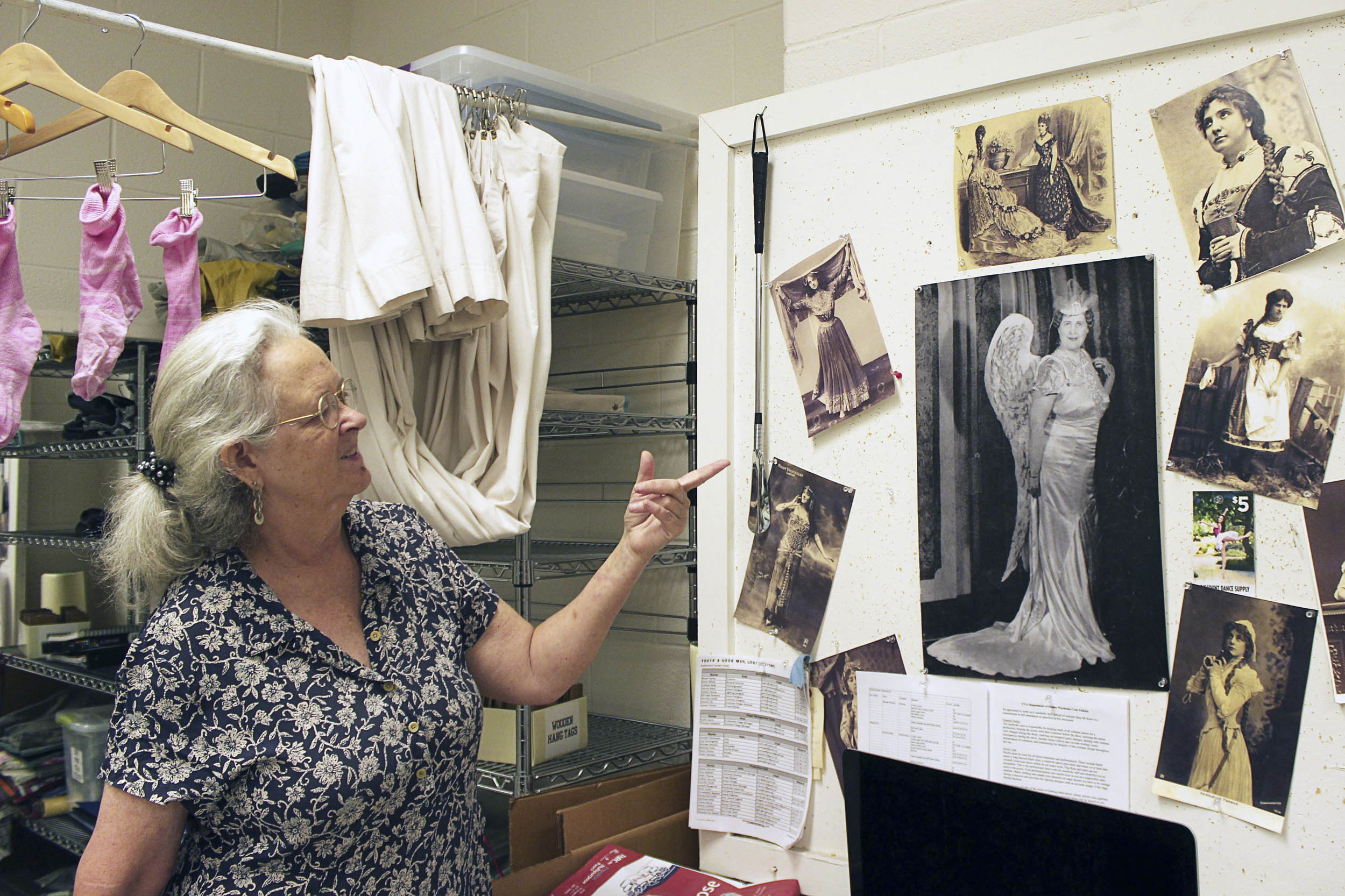 """Dorothy Smith, Heritage Theatre Festival's costume shop designer and costume director, looks at inspirations for the costumes used in the company's production of the fantasia, """"Souvenir."""""""
