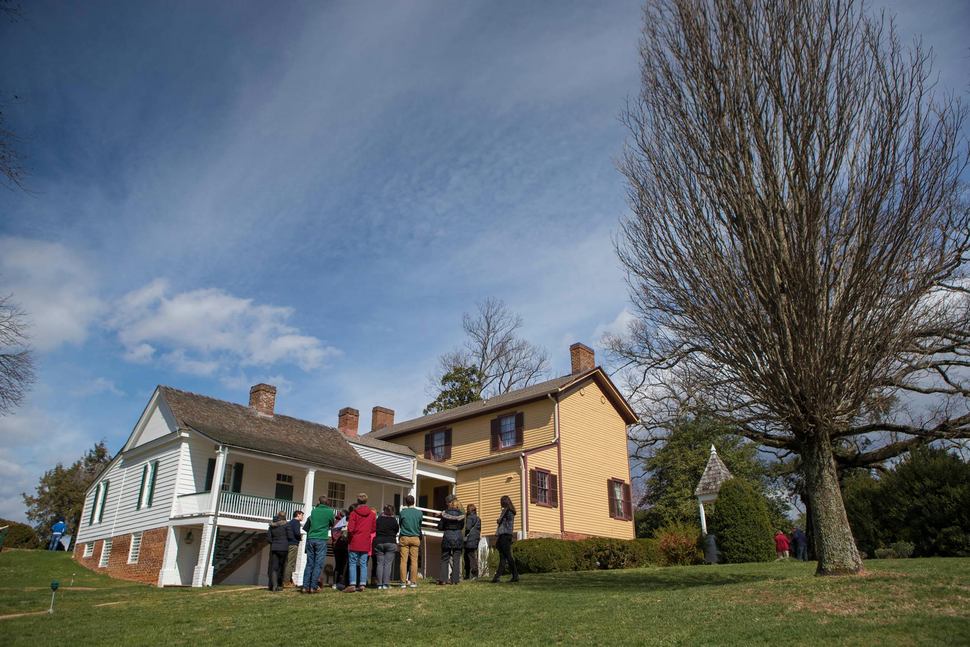 Above, the white house behind the students is now believed to have been Monroe's guest house. Remains of his original home have been discovered in front of the adjoining building, called the Massey House.
