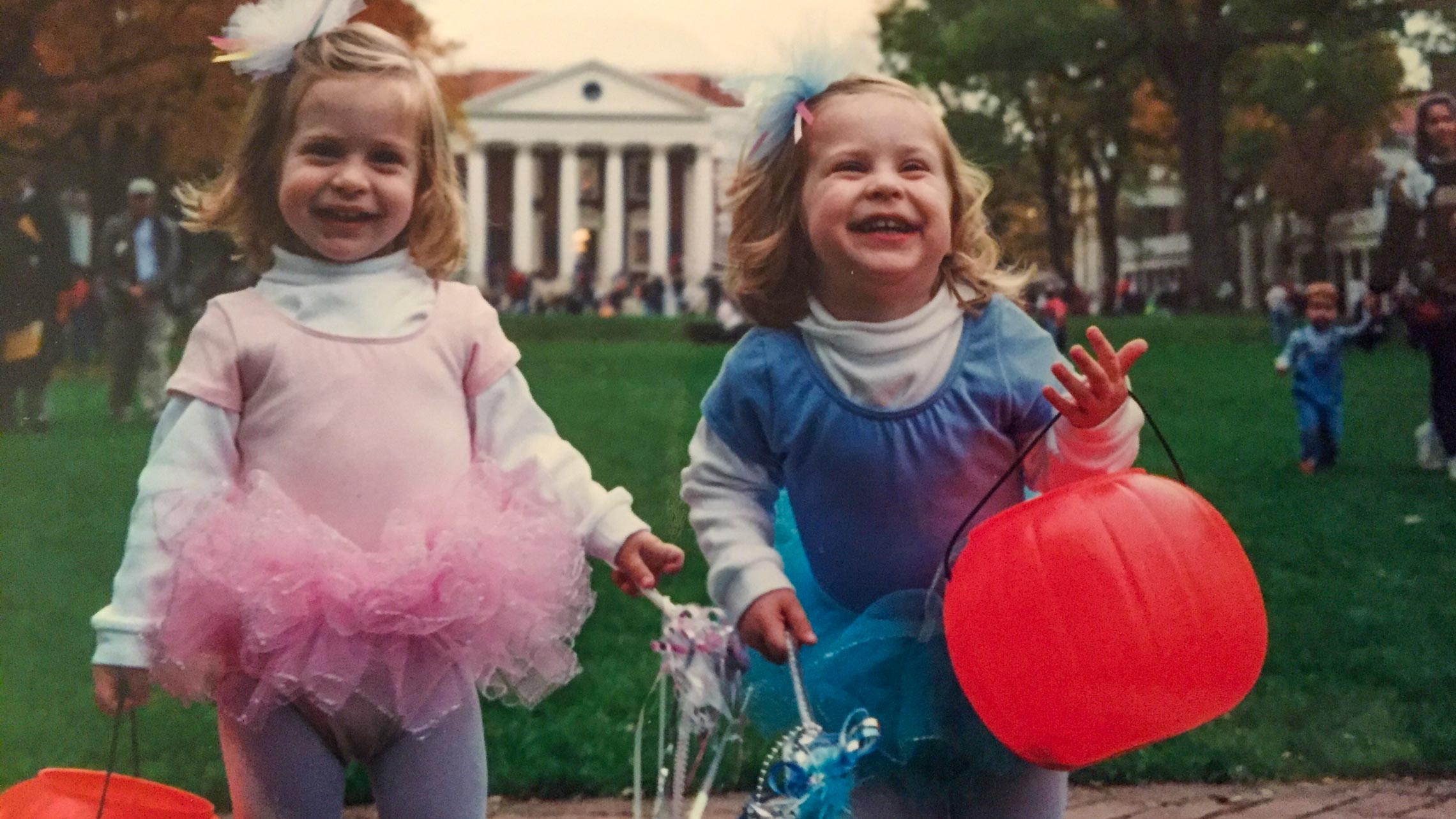 Two blonde little girls in matching fairy costumes.