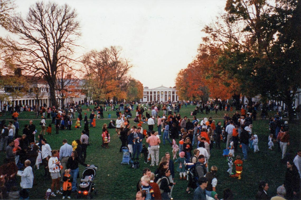 A crowd of people in costumes on the Lawn at UVA