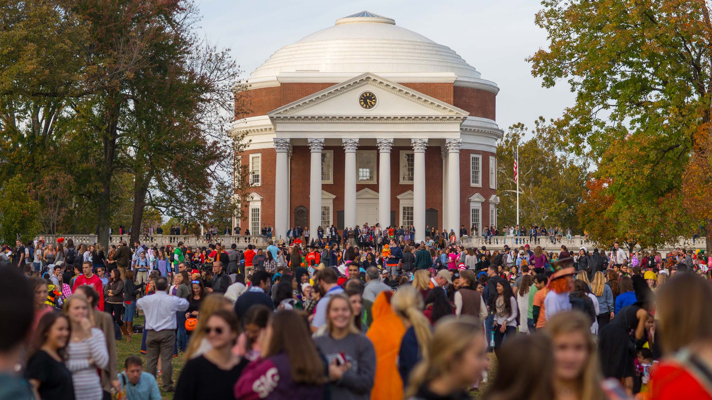 A large crowd of people in costumes in front of the UVA Rotunda