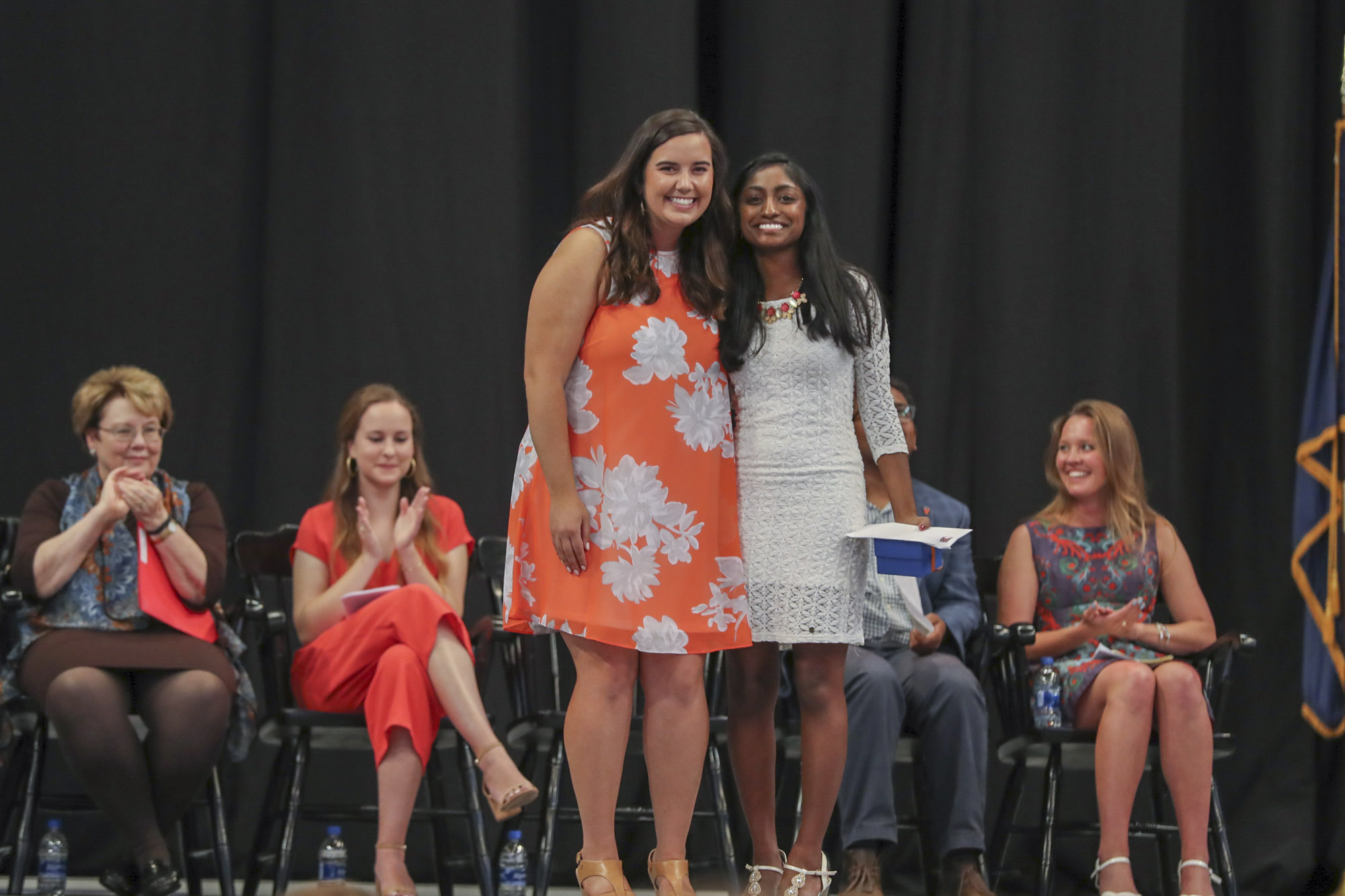 Holly Stevens, left, presented the Cultural Fluency Award to Nivedha Kannapadi, a neuroscience and English major.