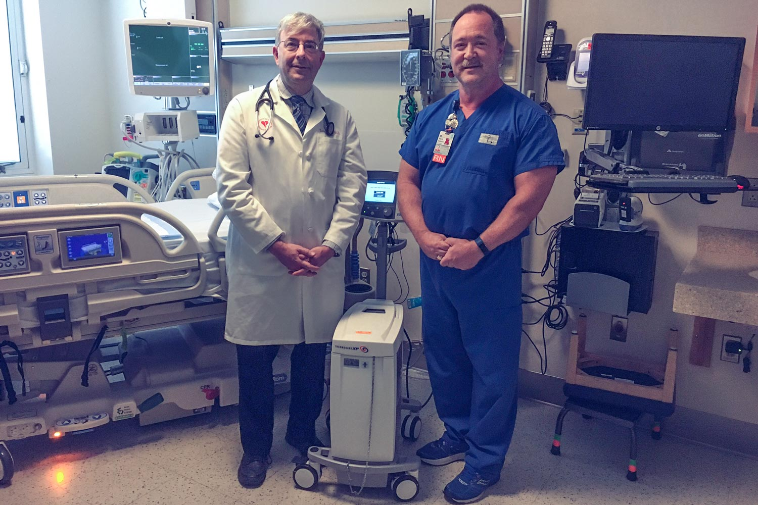 Dr. Lawrence W. Gimple, left, and Mark Adams, nurse manager of UVA's Coronary Care Unit, were among the researchers who developed the model.