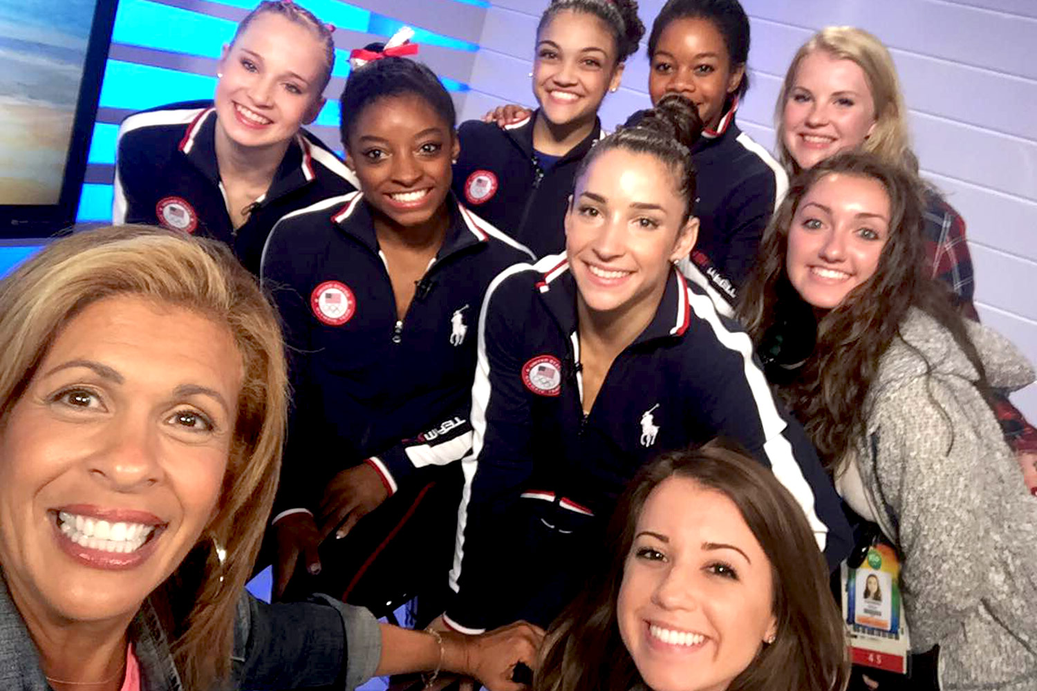 """D'Elia, far right, and another NBC runner pose with the U.S. women's gymnastics team and """"Today"""" co-host Hoda Kotb."""